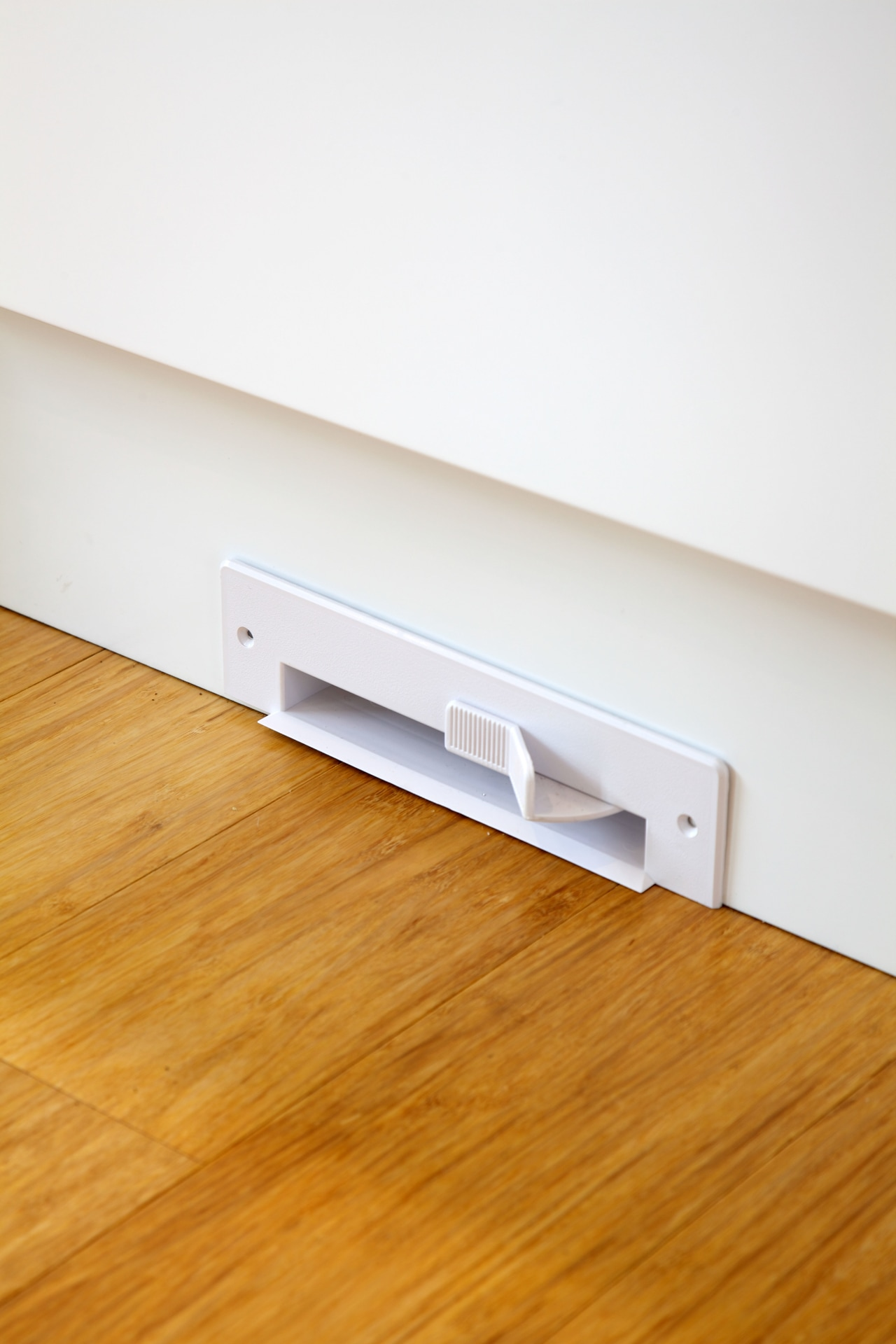 A vacuum vent in the kitchen can be floor, flooring, furniture, hardwood, laminate flooring, line, product design, table, wall, wood, wood flooring, white, orange