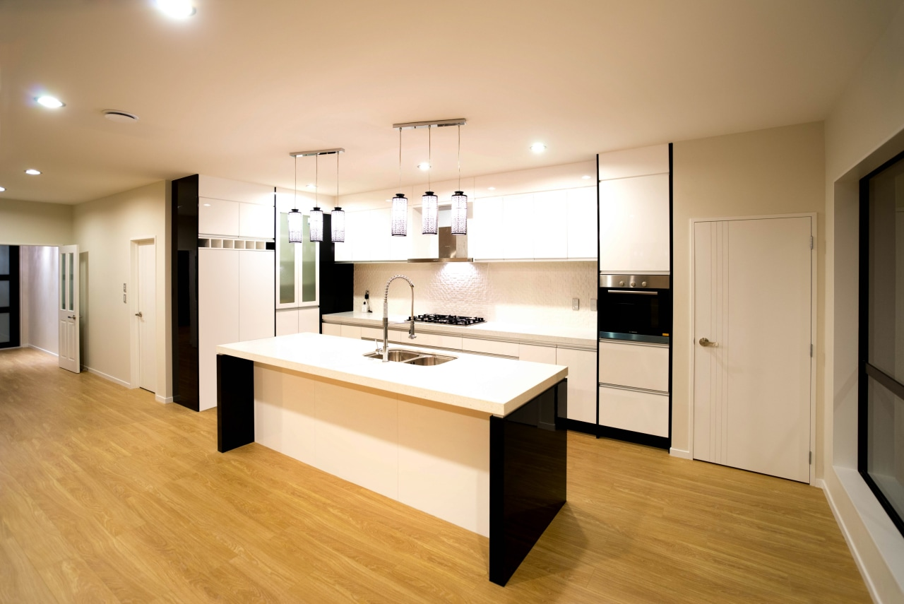 Beautiful kitchens dont just happen by accident  cabinetry, countertop, floor, flooring, hardwood, interior design, kitchen, laminate flooring, real estate, room, wood, wood flooring, orange, white