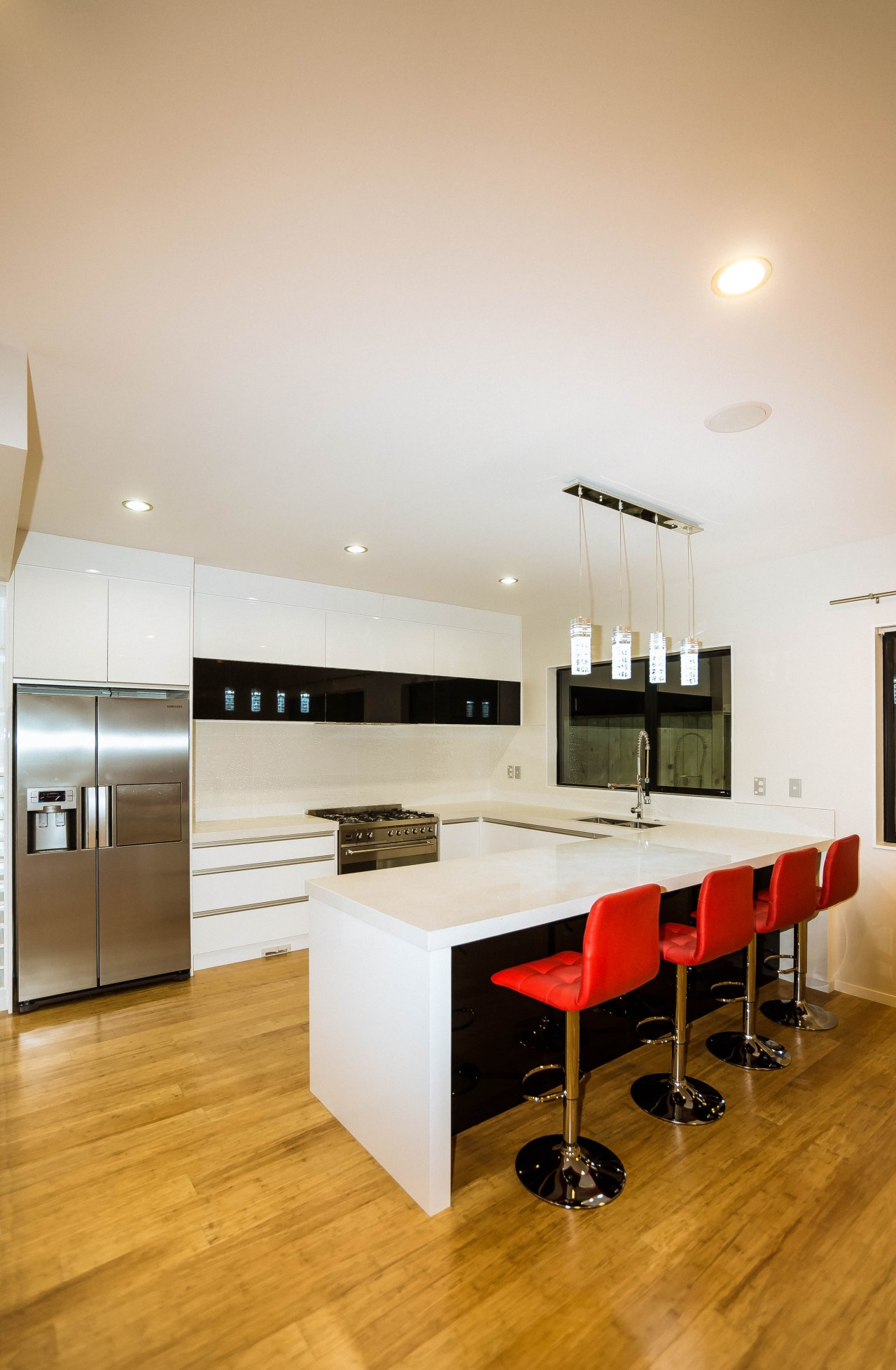 Reno4u has a solution to every tricky kitchen ceiling, countertop, floor, flooring, furniture, hardwood, interior design, kitchen, laminate flooring, real estate, room, table, wood, wood flooring, white, orange