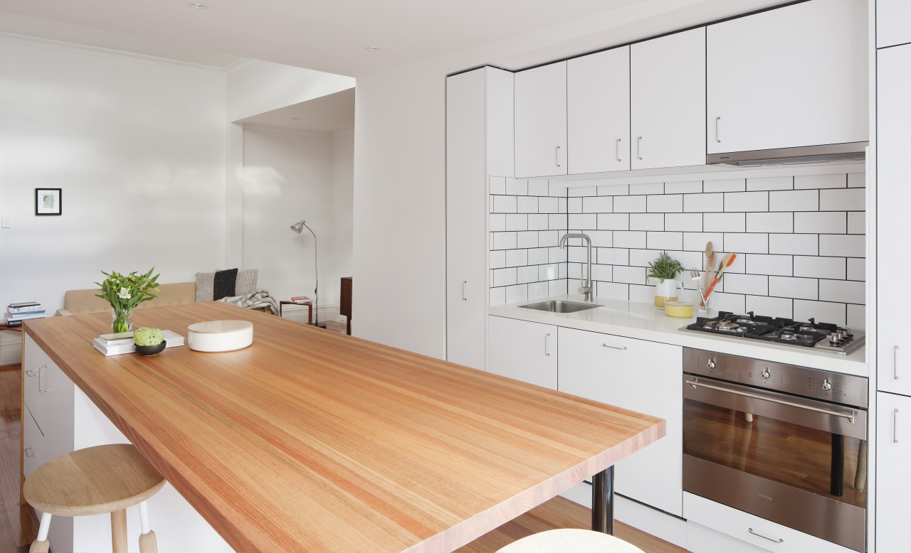 White cabinets, subway tiles and mid-tone timber finishes countertop, cuisine classique, floor, interior design, kitchen, property, real estate, gray