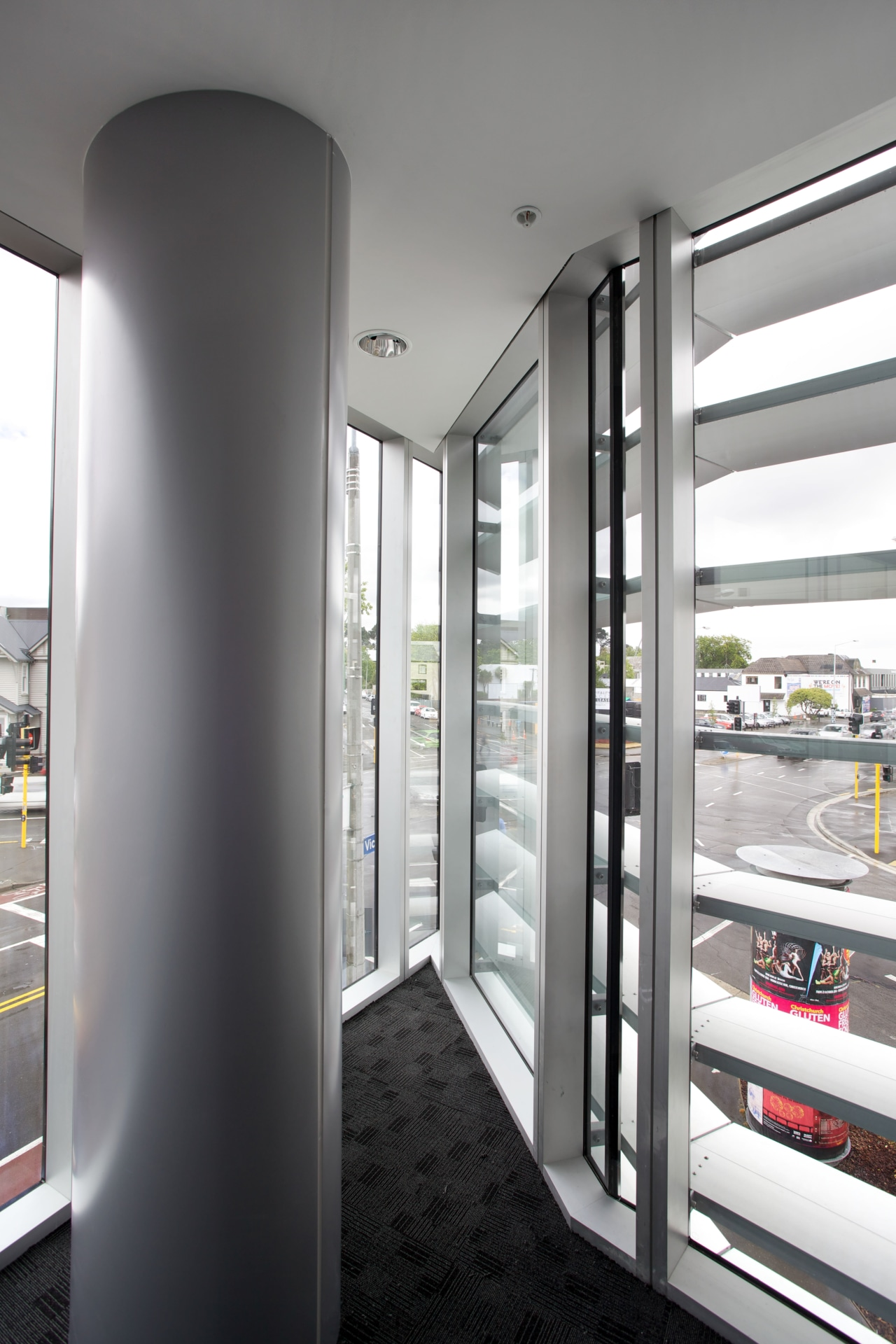 A slight kink in this new building allows interior design, structure, window, gray, white