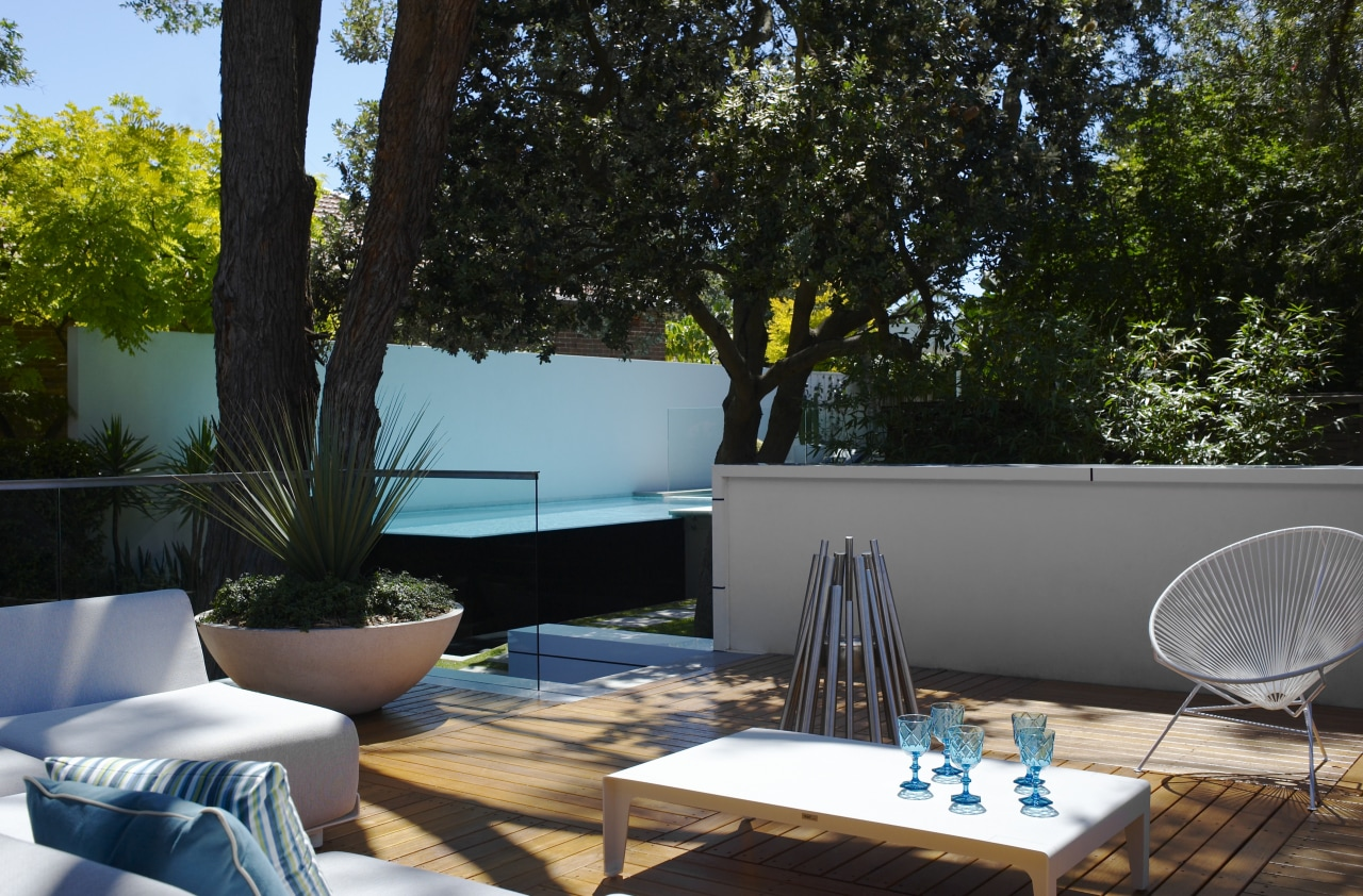 Mature trees provide dappled shade to the patio backyard, furniture, home, house, interior design, outdoor furniture, outdoor structure, patio, plant, swimming pool, table, tree, black