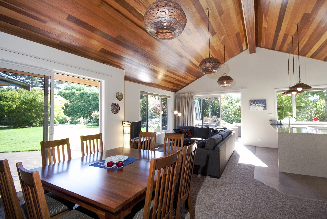 A raked cedar ceiling adds visual warmth, and ceiling, dining room, estate, home, house, interior design, property, real estate, table, gray