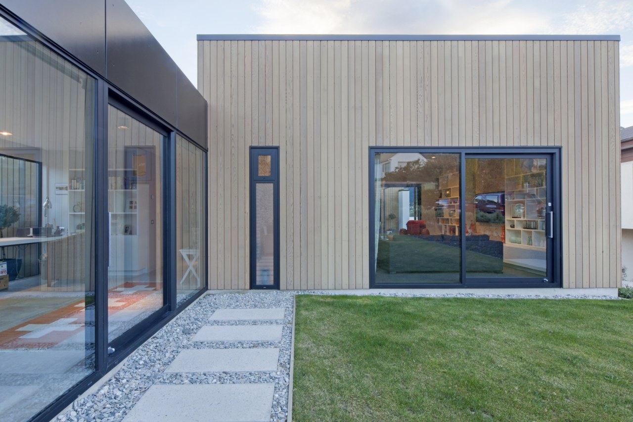 On this home, both window systems avoid the architecture, facade, home, house, real estate, window, gray