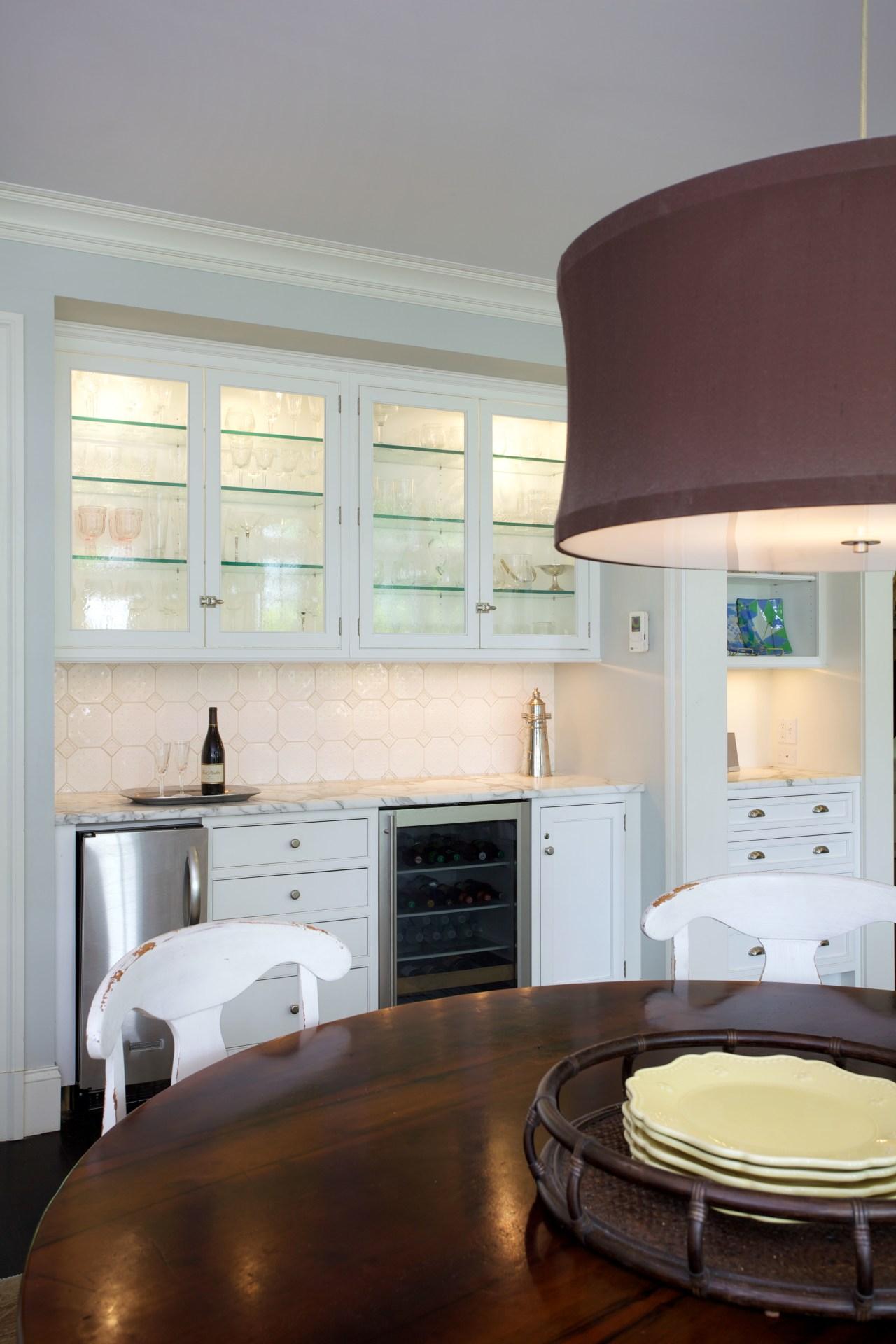 This breakfast area adjacent to the kitchen includes cabinetry, countertop, cuisine classique, floor, home, interior design, kitchen, living room, room, window, gray