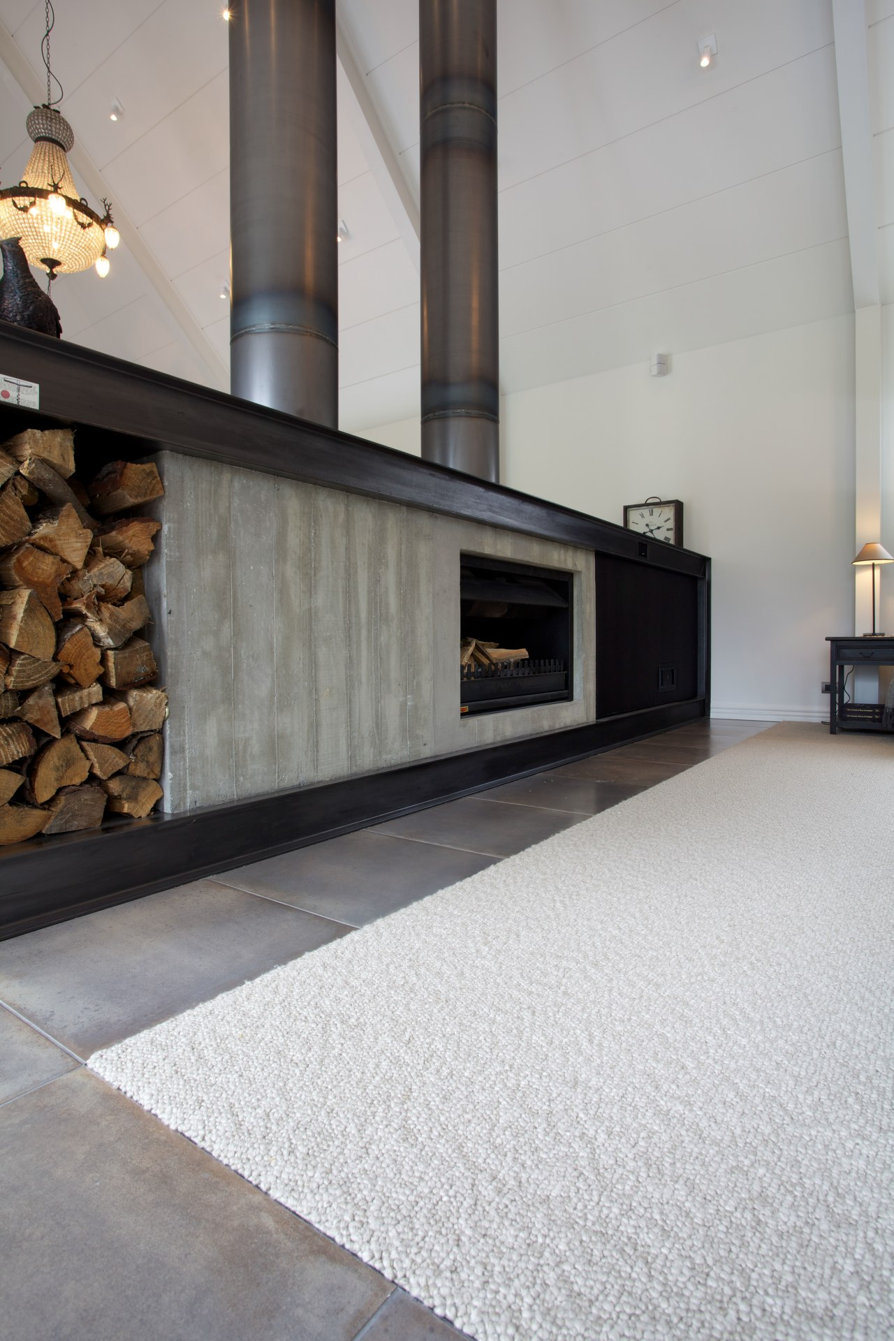 Pure New Zealand lambswool provides a soft, comfortable fireplace, floor, flooring, hearth, interior design, living room, tile, wood flooring, gray