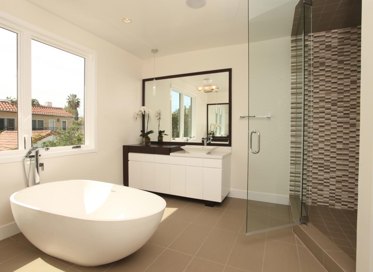 In this bathroom project by designer Christopher Grubb, bathroom, estate, floor, flooring, home, interior design, property, real estate, room, tile, window, orange