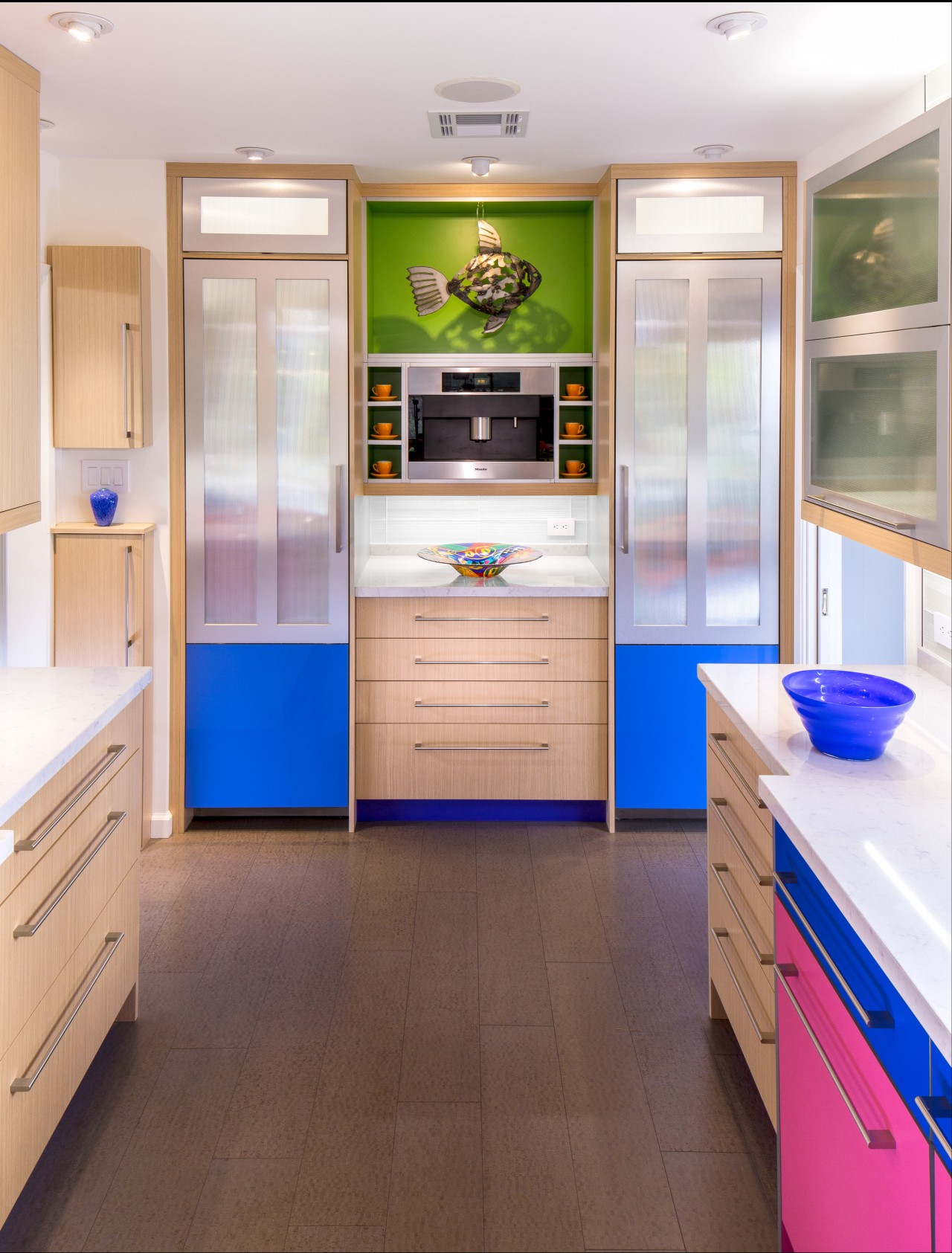 In this colorful kitchen, twin columns accommodating a cabinetry, countertop, home appliance, interior design, kitchen, room, white