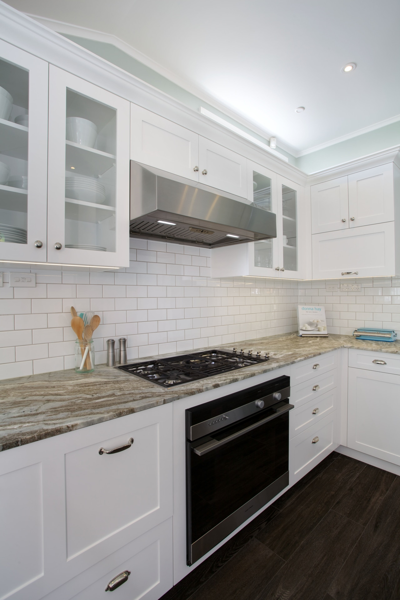 The ventilation unit in this kitchen was custom cabinetry, countertop, cuisine classique, floor, flooring, hardwood, home appliance, interior design, kitchen, kitchen appliance, kitchen stove, major appliance, room, tile, wood flooring, gray