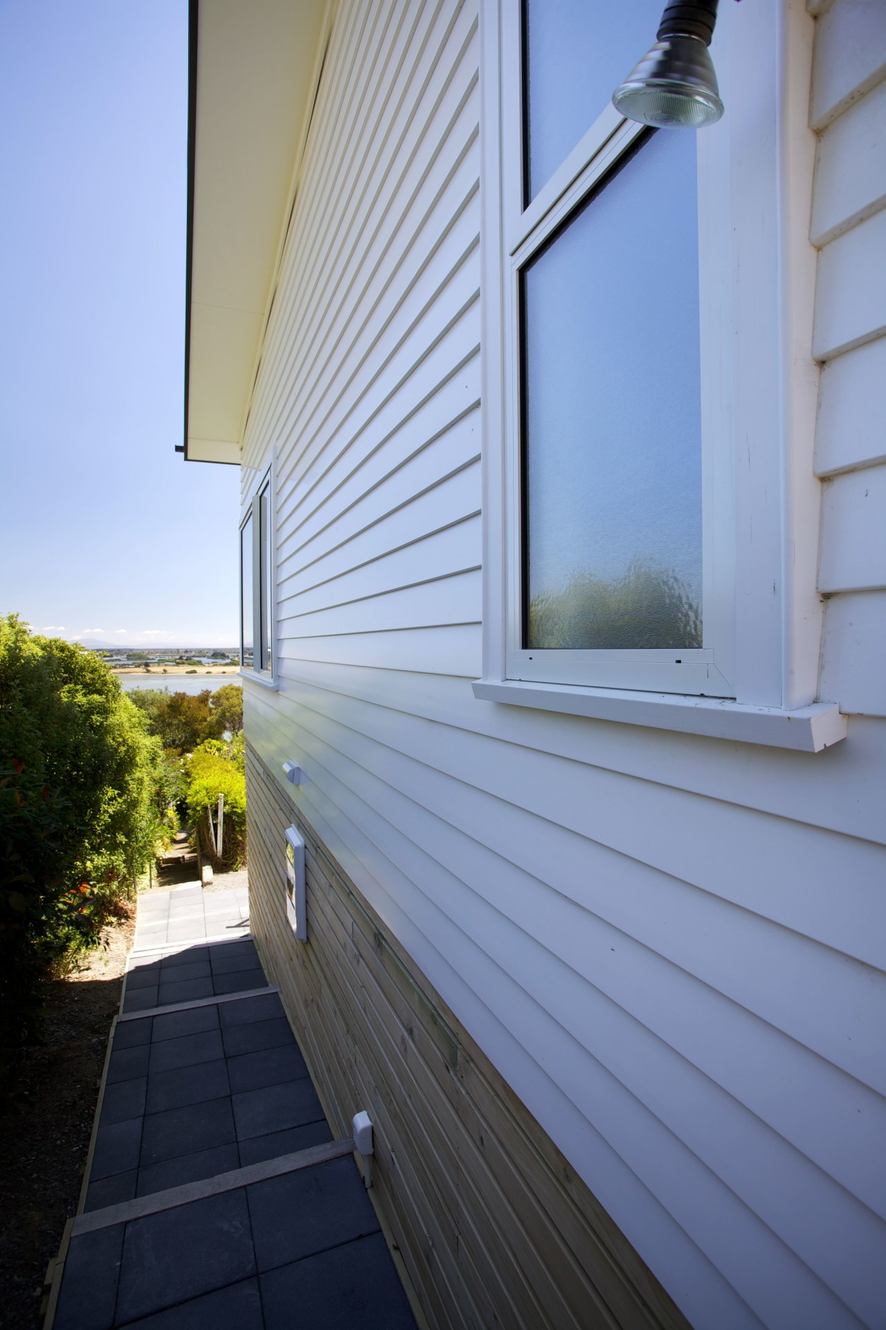 Palliside is a low-maintenance cladding solution that never architecture, building, daylighting, facade, home, house, real estate, residential area, roof, siding, sky, window, wood, teal