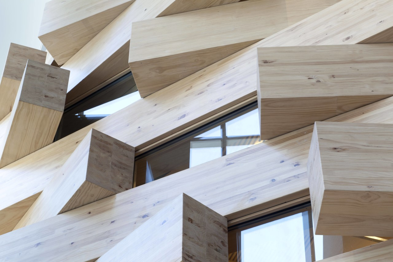 Interlocking timber blocks form an interior facade at angle, architecture, beam, daylighting, floor, hardwood, lumber, plywood, product design, wood, wood stain, gray, white
