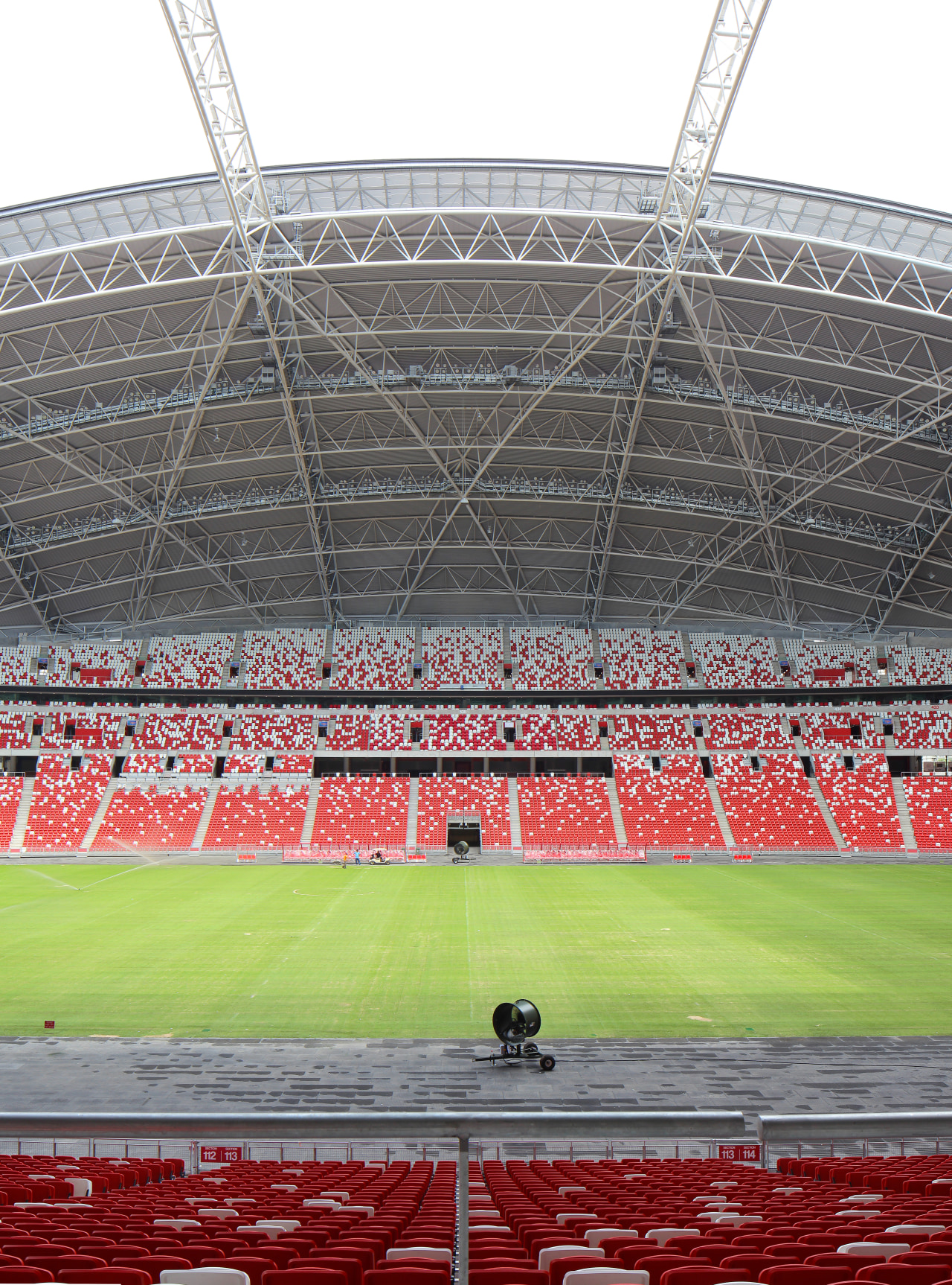 The vast size of the stadium at the area, arena, atmosphere, grass, line, soccer specific stadium, sport venue, stadium, structure, gray