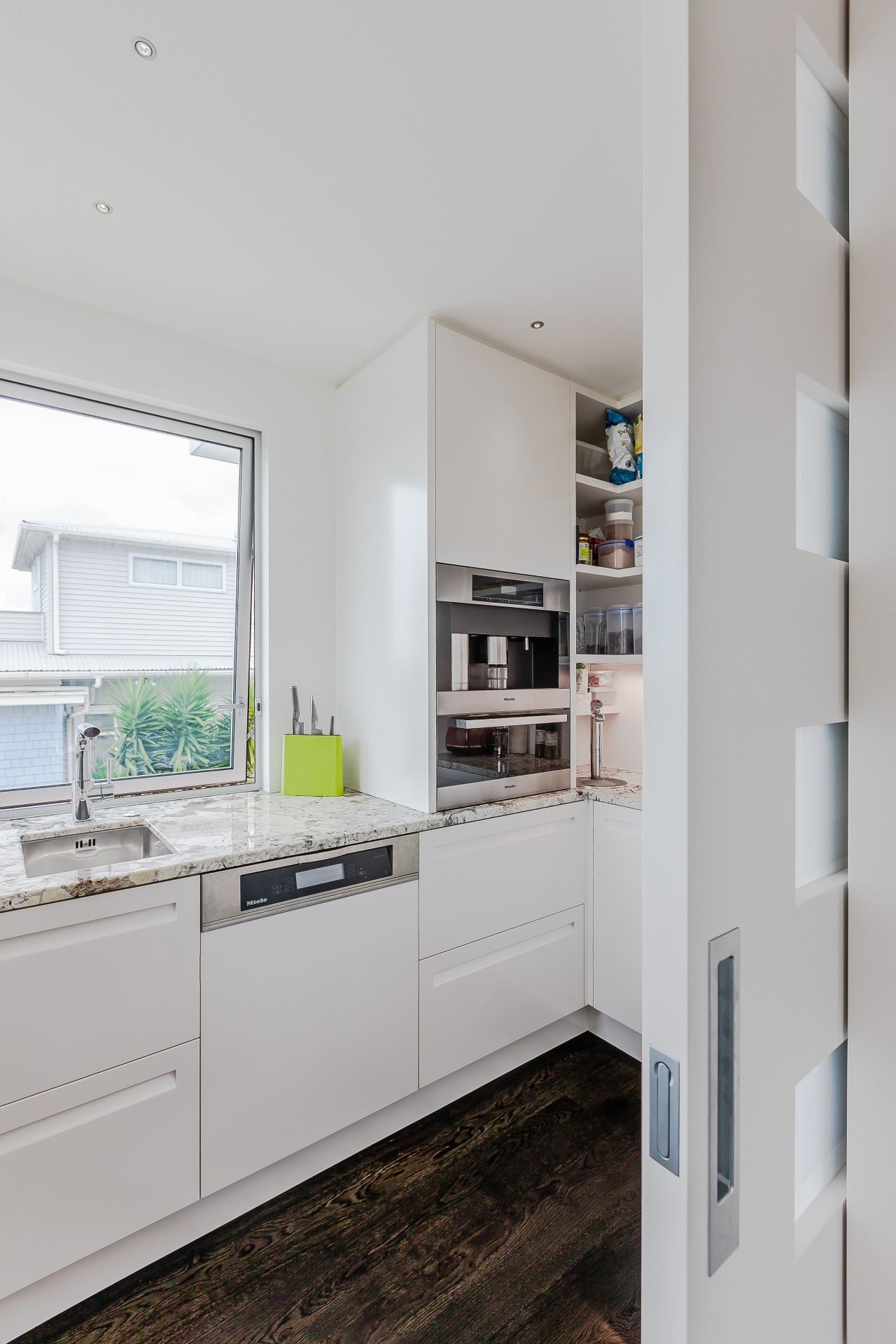 Hidden behind a sliding door, the scullery in cabinetry, countertop, cuisine classique, home appliance, interior design, kitchen, refrigerator, gray