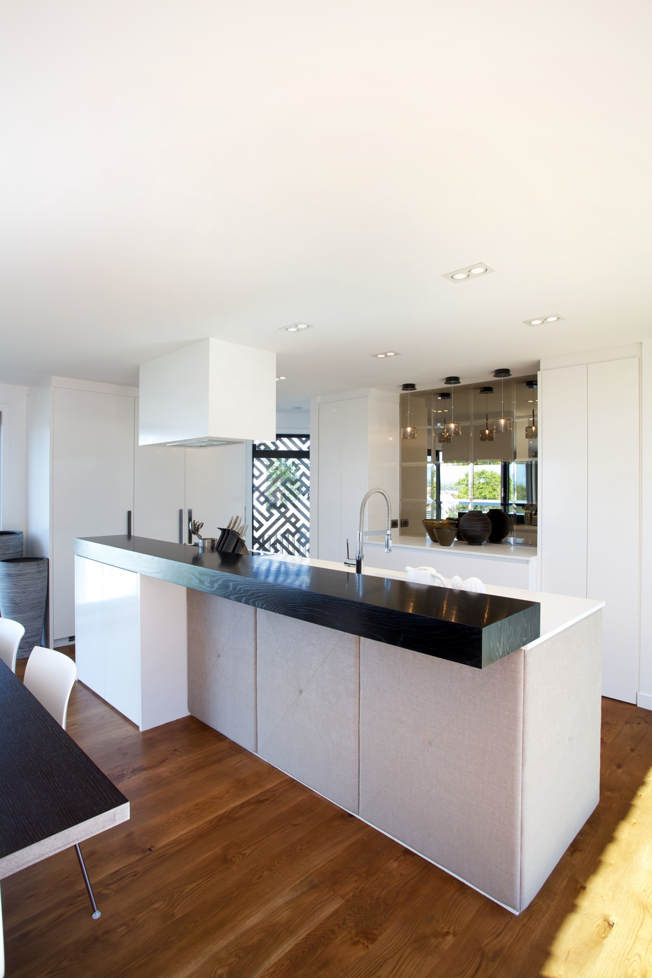 This contemporary townhouse designed by Paul Izzard features architecture, countertop, floor, house, interior design, kitchen, real estate, room, white