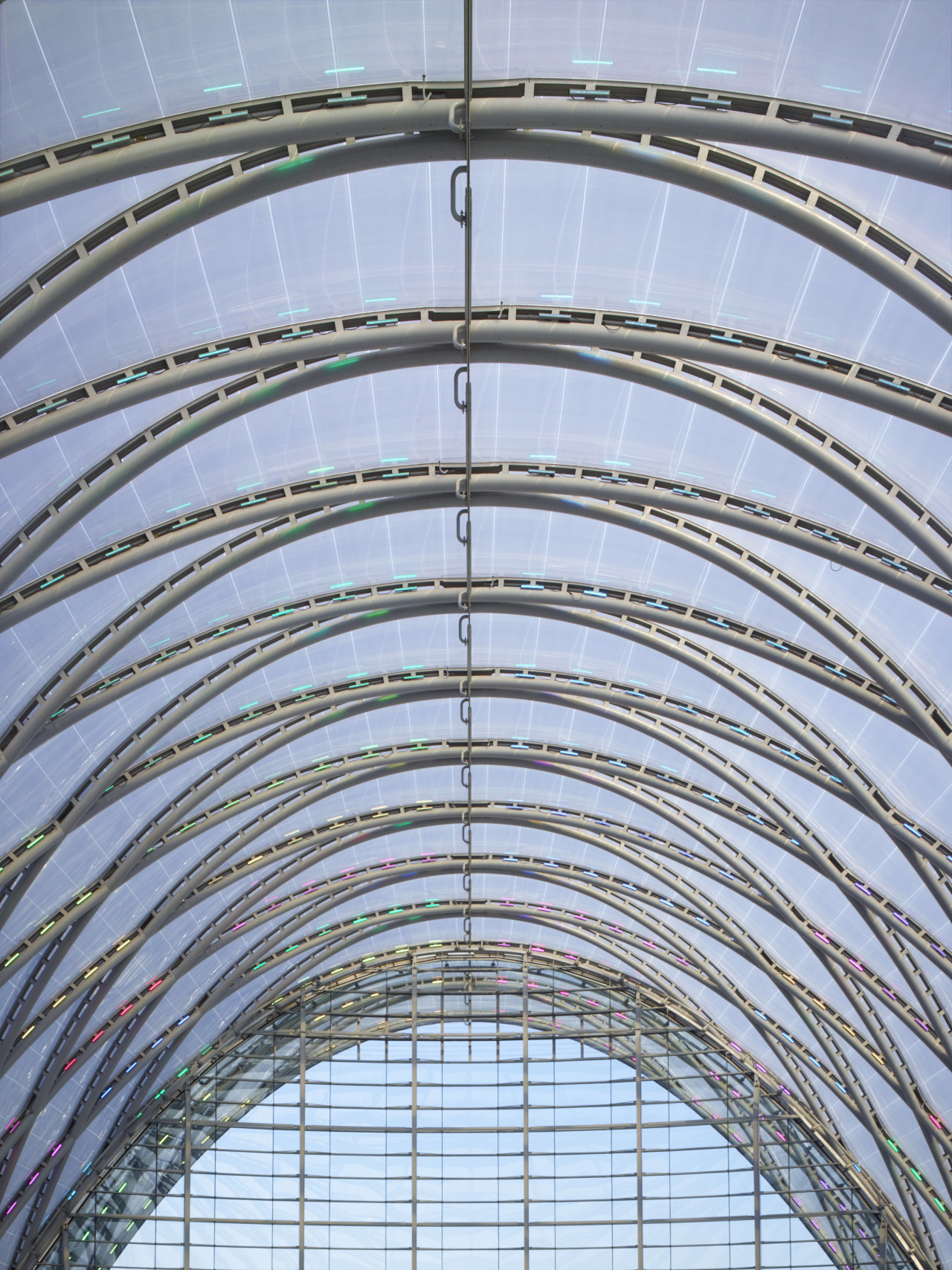 The new ARTIC transport hub in Anaheim features arch, architecture, building, daylighting, facade, fixed link, line, sky, structure, symmetry, teal, gray