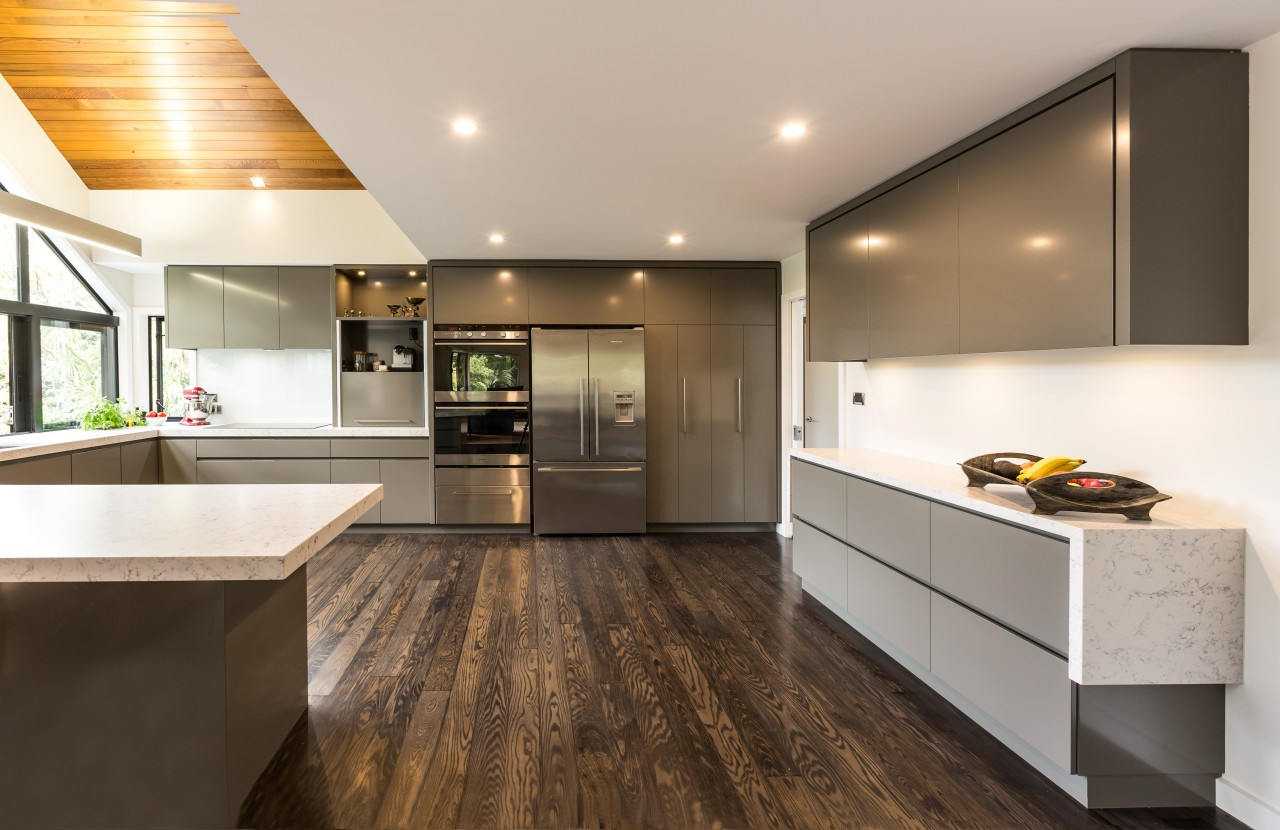 This new kitchen by Kitchens By Design teams cabinetry, countertop, cuisine classique, floor, flooring, hardwood, interior design, kitchen, laminate flooring, real estate, room, wood flooring, gray, brown