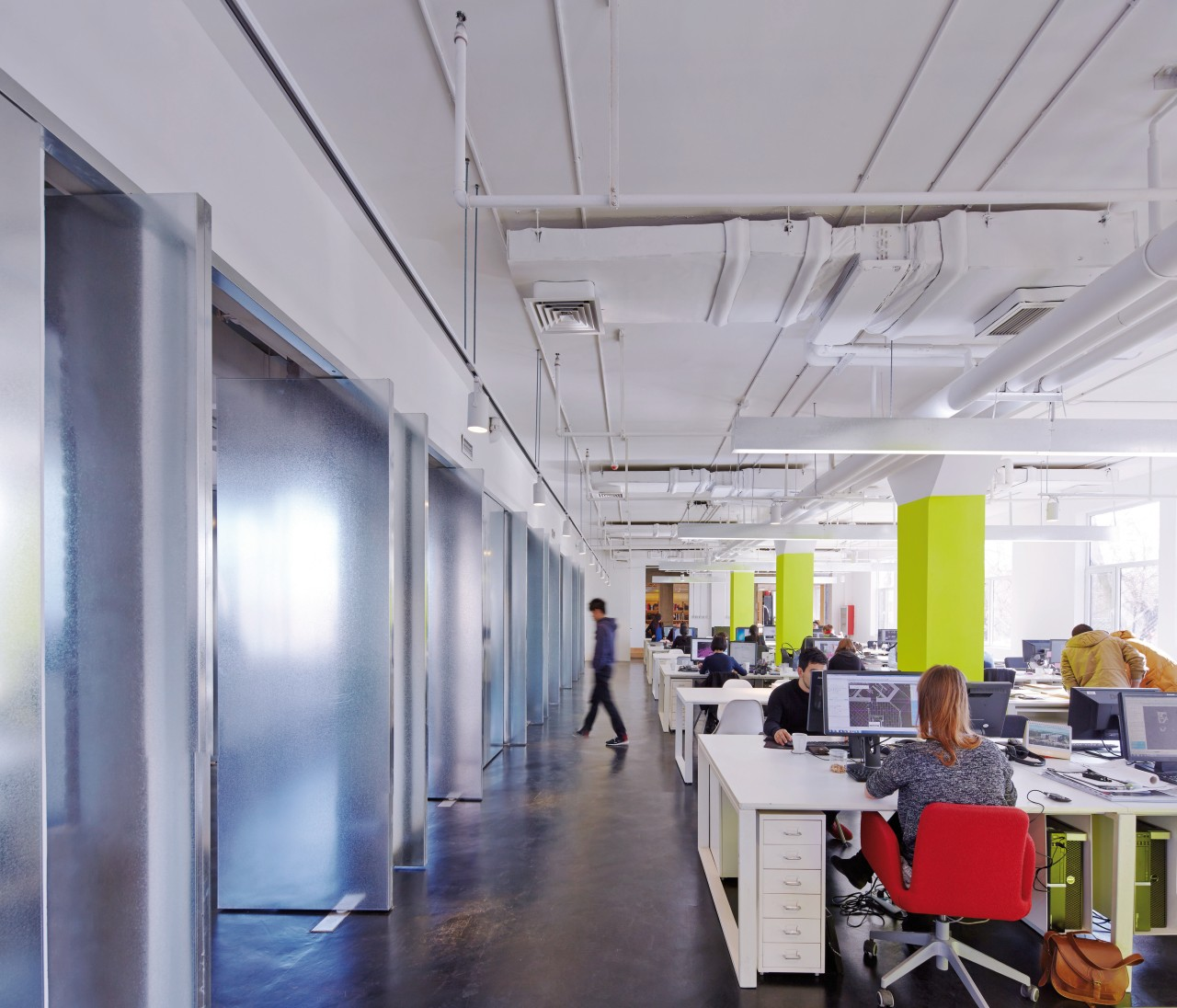 Full-height metal-wrapped pivoting doors allow sightlines through the ceiling, daylighting, interior design, office, gray