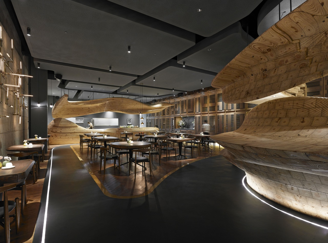 In Raw restaurant in Taipei, a large wood architecture, ceiling, interior design, restaurant, black, brown