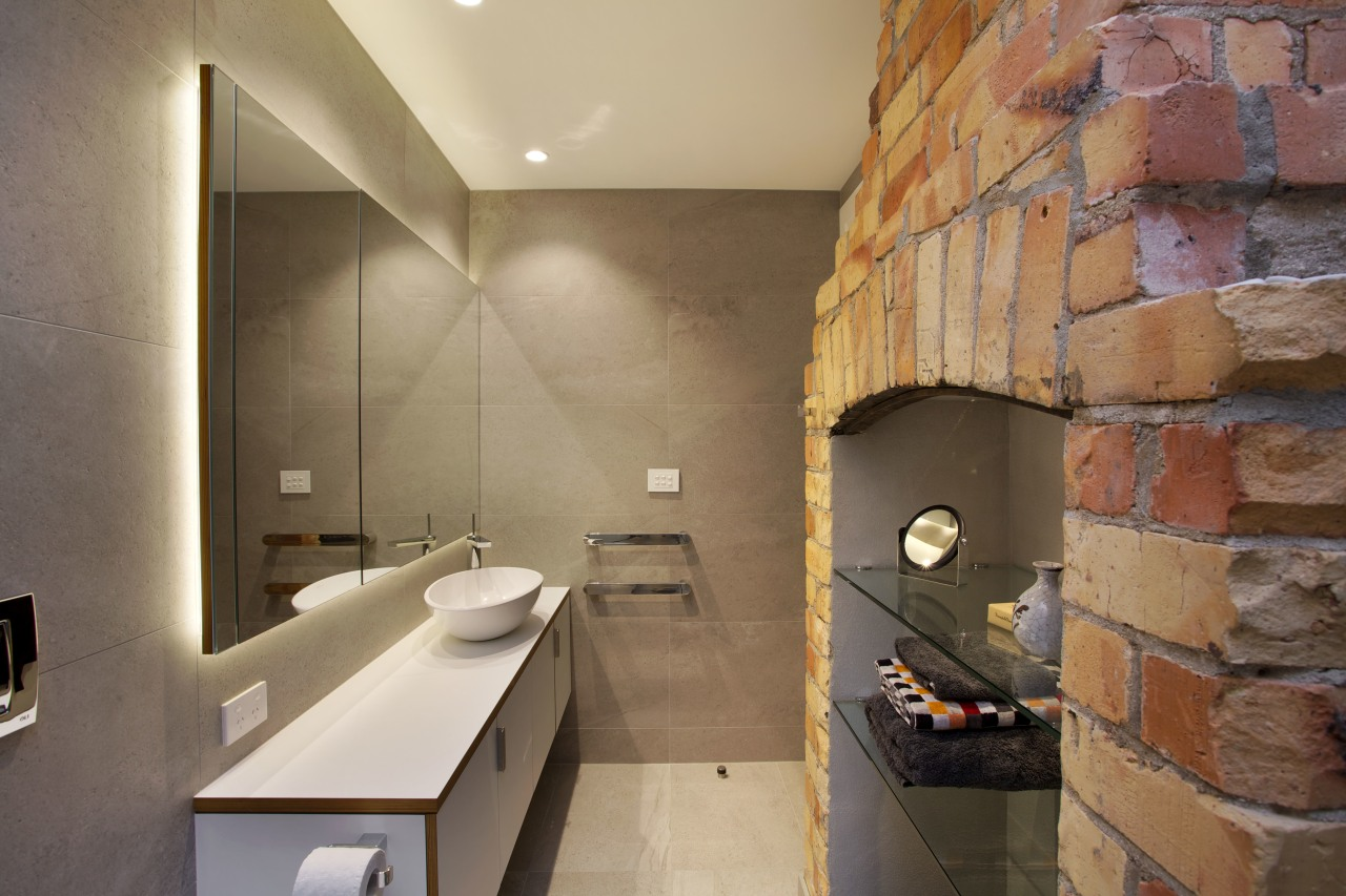 The original double-sided fireplace in this renovated villa architecture, bathroom, floor, interior design, room, tile, brown, orange