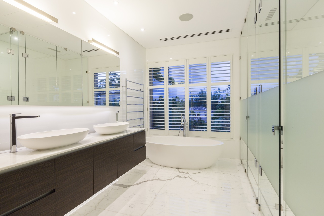 The master suite in this remodelled 1970s house bathroom, estate, home, interior design, property, real estate, room, white, gray