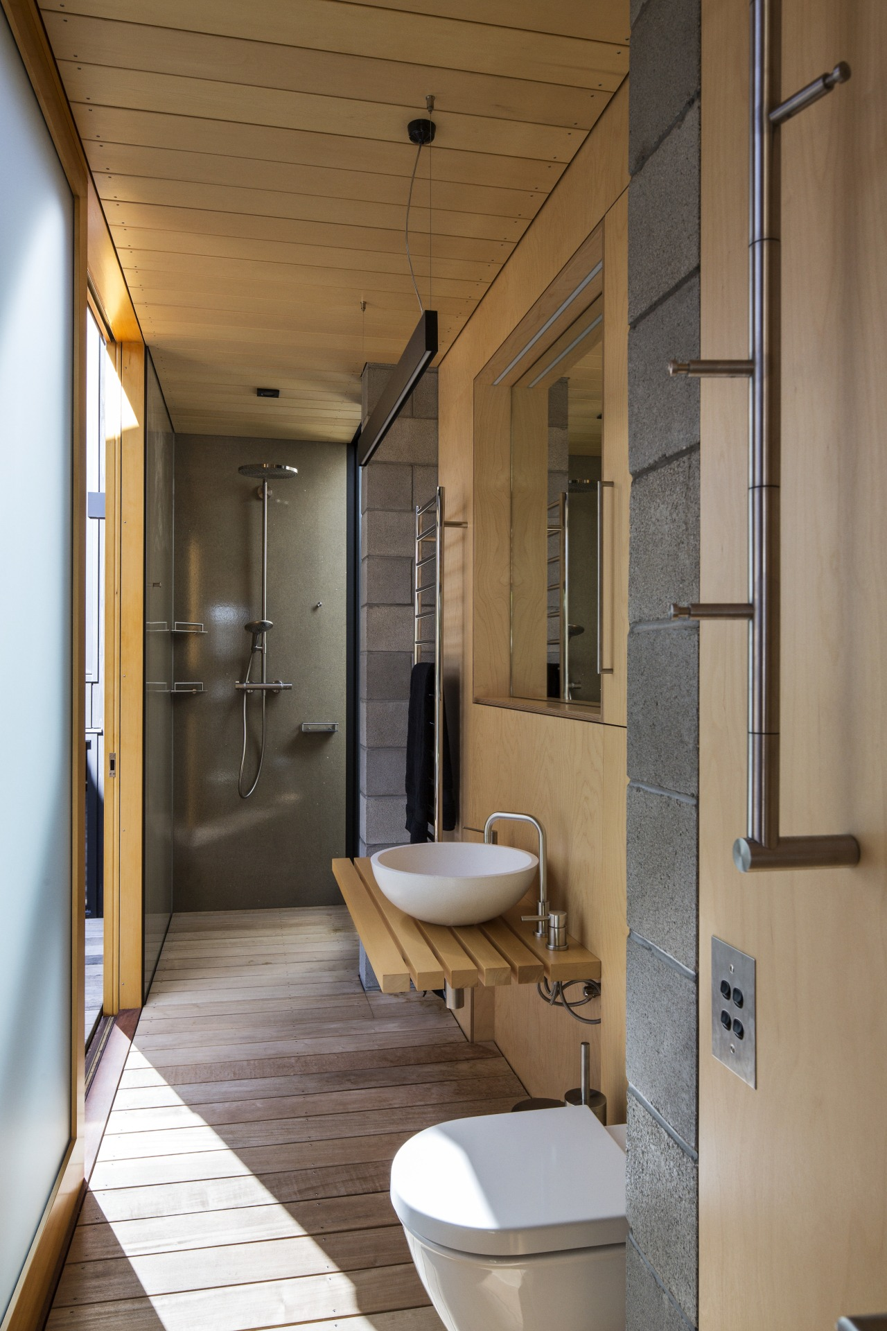This family bathroom opens to a courtyard, and architecture, bathroom, house, interior design, real estate, room, brown, gray