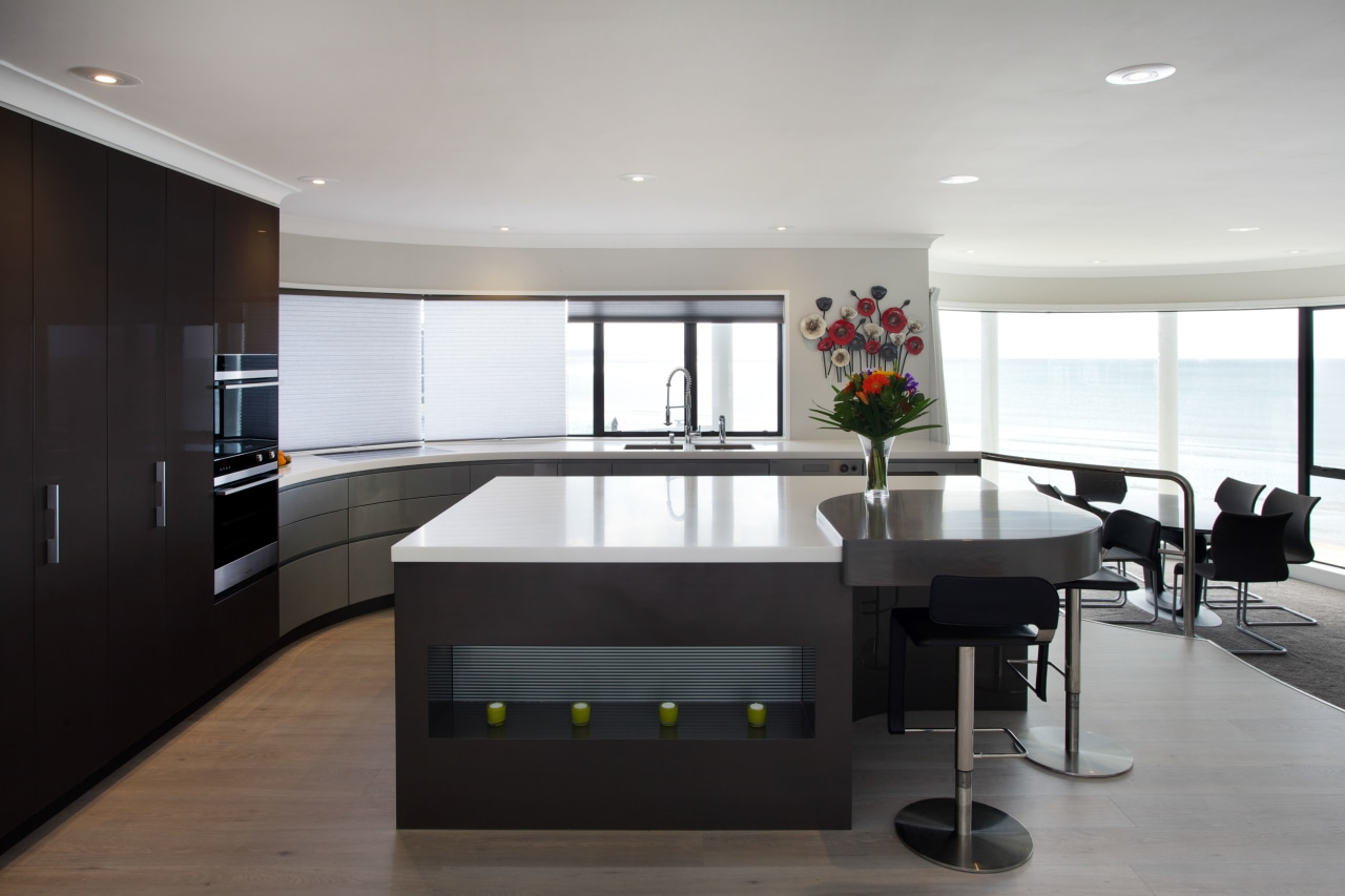 Soft curves balance the square edges on the countertop, interior design, kitchen, real estate, gray, black