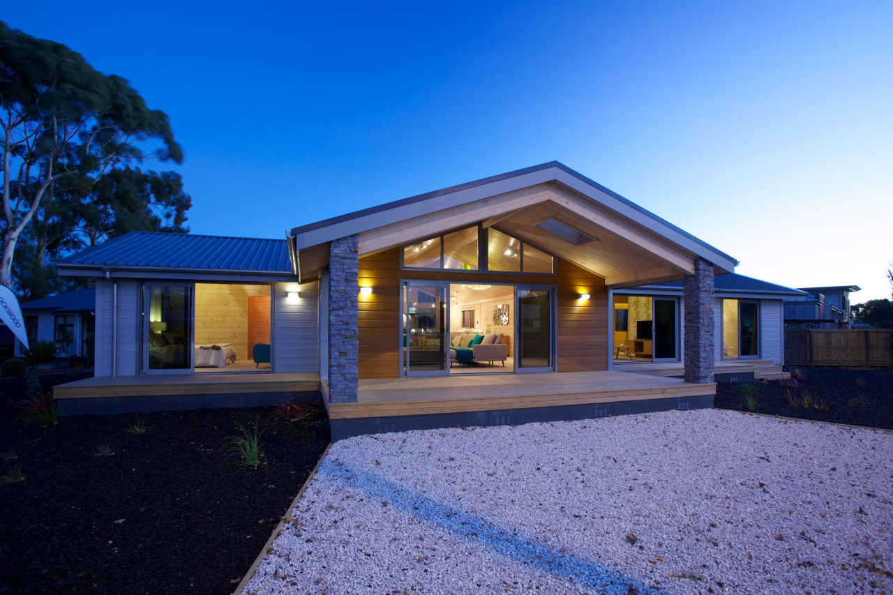 The new Lockwood show home in Christchurch features architecture, cottage, elevation, estate, facade, home, house, lighting, property, real estate, residential area, roof, siding, sky, window, blue