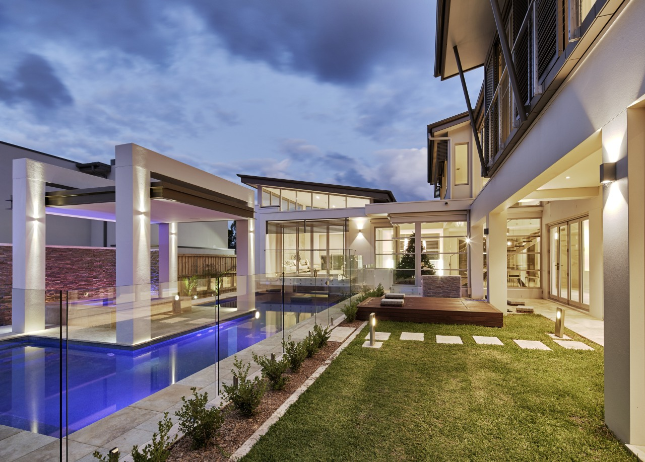 This house, by Starr Constructions, features a large apartment, architecture, condominium, estate, home, house, interior design, mixed use, property, real estate, residential area, swimming pool, villa