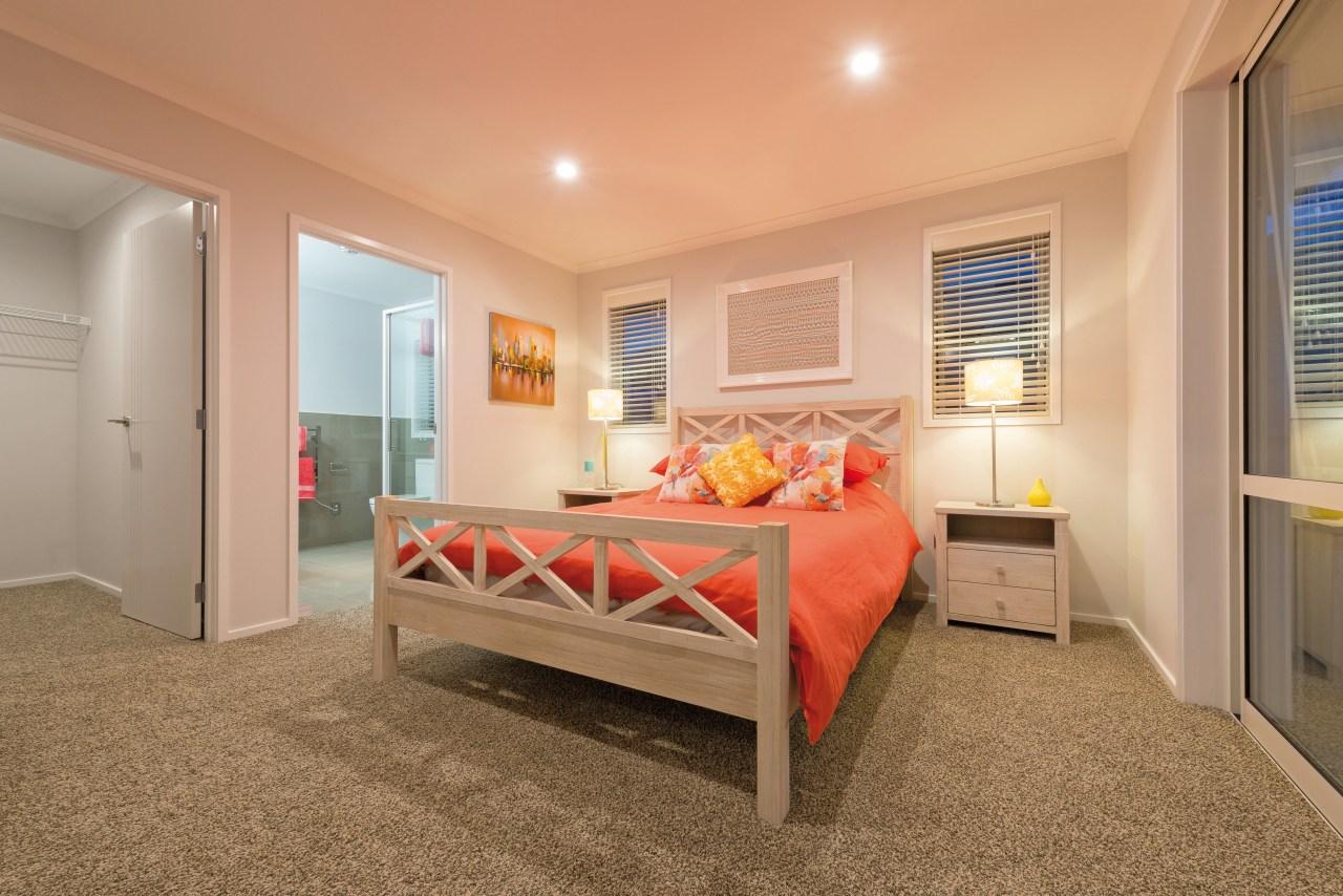 The master suite in this GJ Gardner Homes bed frame, bedroom, ceiling, floor, home, interior design, property, real estate, room, orange, brown