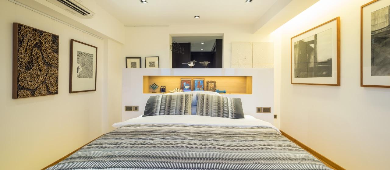 The master suite in this remodelled apartment occupies bedroom, ceiling, estate, home, interior design, property, real estate, room, suite, orange
