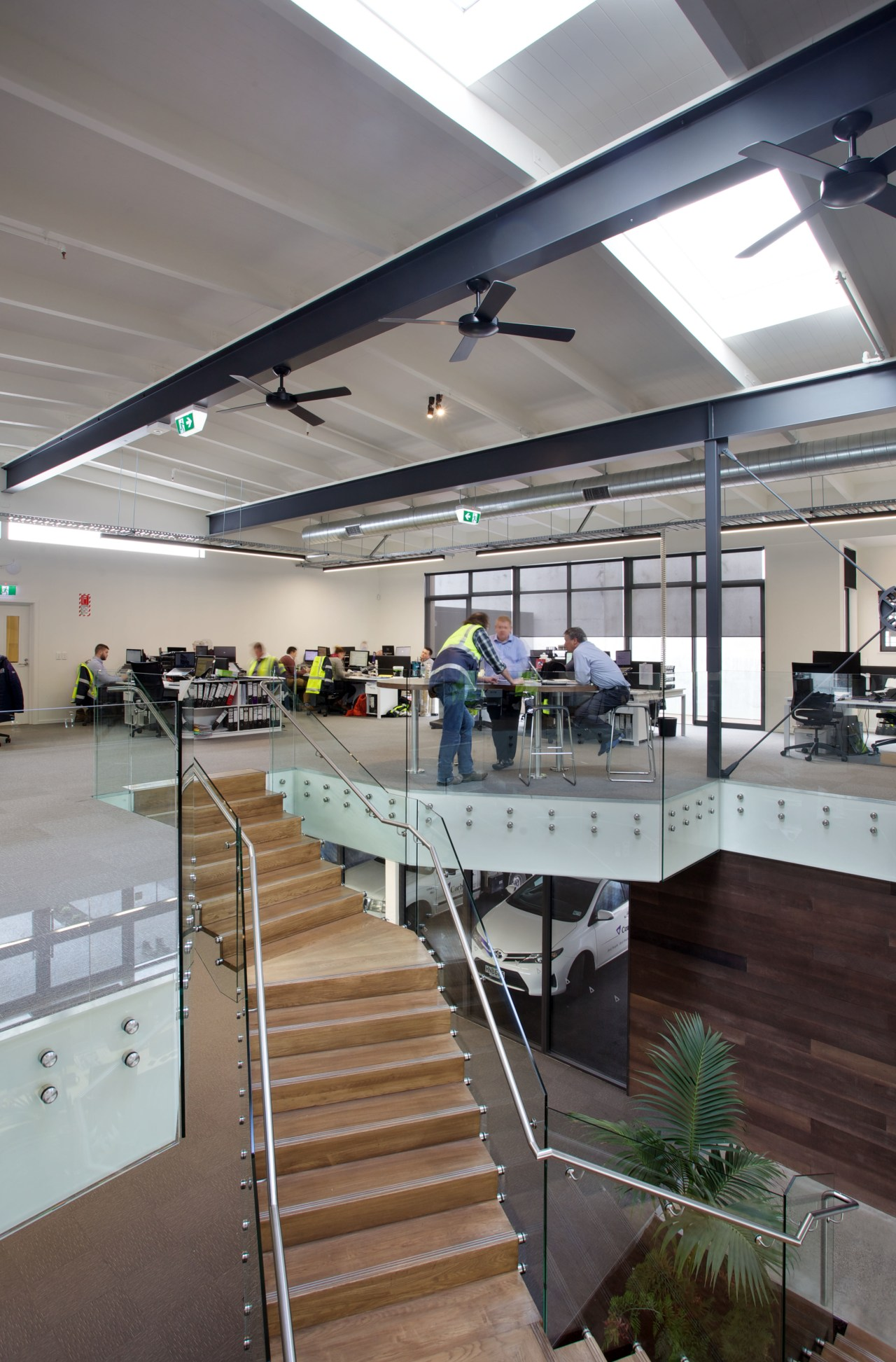 An open-plan work environment reflects Corbel Constructions collaborative architecture, daylighting, interior design, gray