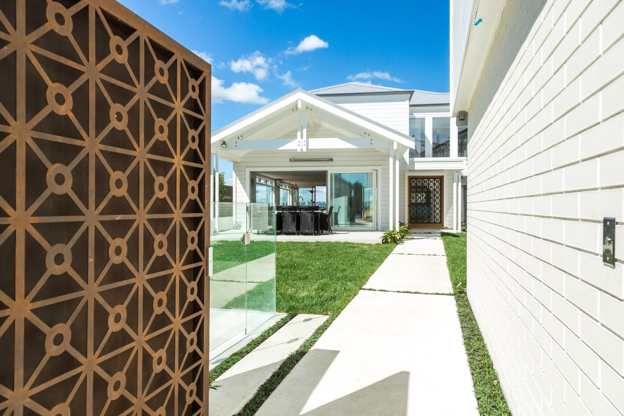 Metal gate and weatherboard walls on Devonport renovation architecture, building, estate, facade, home, house, property, real estate, white