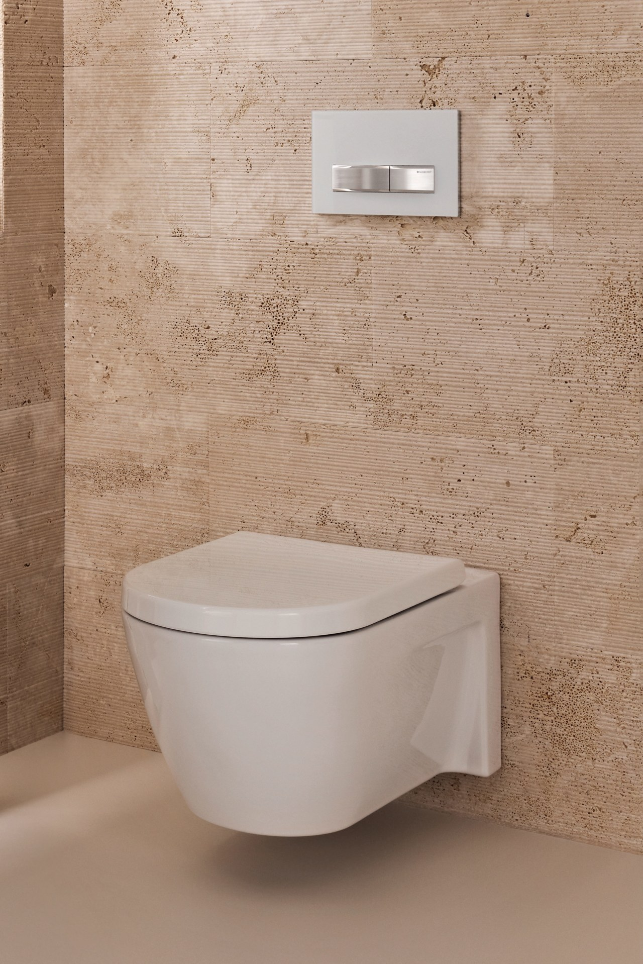 With a concealed inwall cistern, all you see bathroom, bathroom accessory, bathroom sink, bidet, ceramic, floor, plumbing fixture, product, product design, tap, tile, toilet, toilet seat, wall, gray, brown