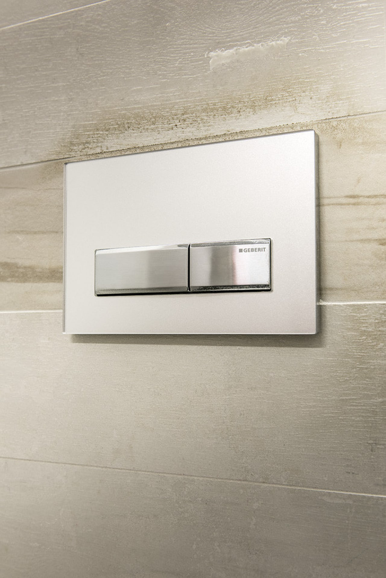 Flush plates are understated and suit a range product design, tap, gray