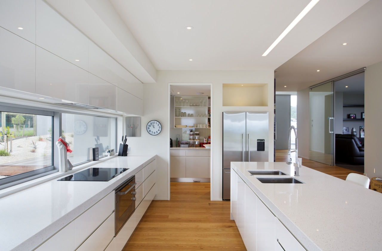 This gleaming chefs kitchen includes every convenience, from countertop, cuisine classique, interior design, kitchen, real estate, room, gray, white