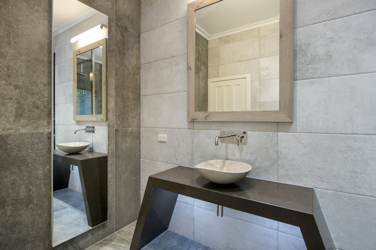 For this dressed to impress bathroom, designer Owen architecture, bathroom, floor, interior design, room, sink, tile, gray