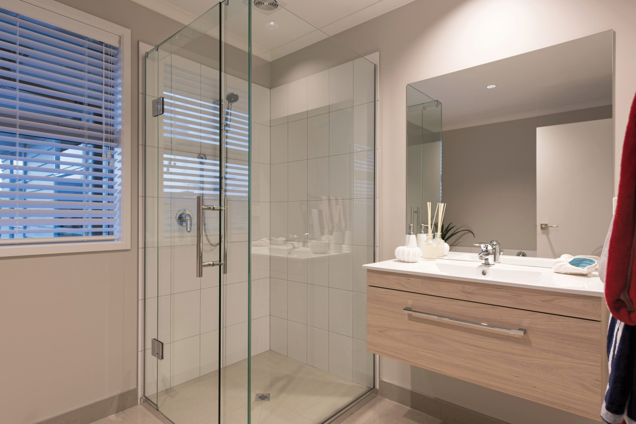 The two bathrooms in this GJ Gardner home bathroom, interior design, room, gray