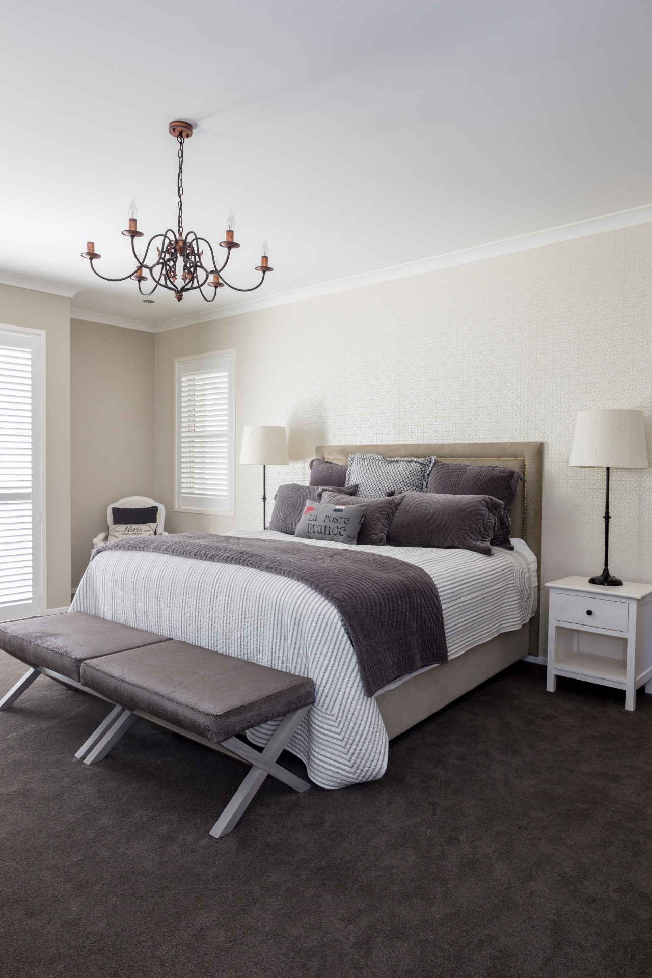 In this Yellowfox project, the master bed-room has bed, bed frame, bedroom, ceiling, floor, flooring, furniture, home, interior design, room, wall, wood, gray, black