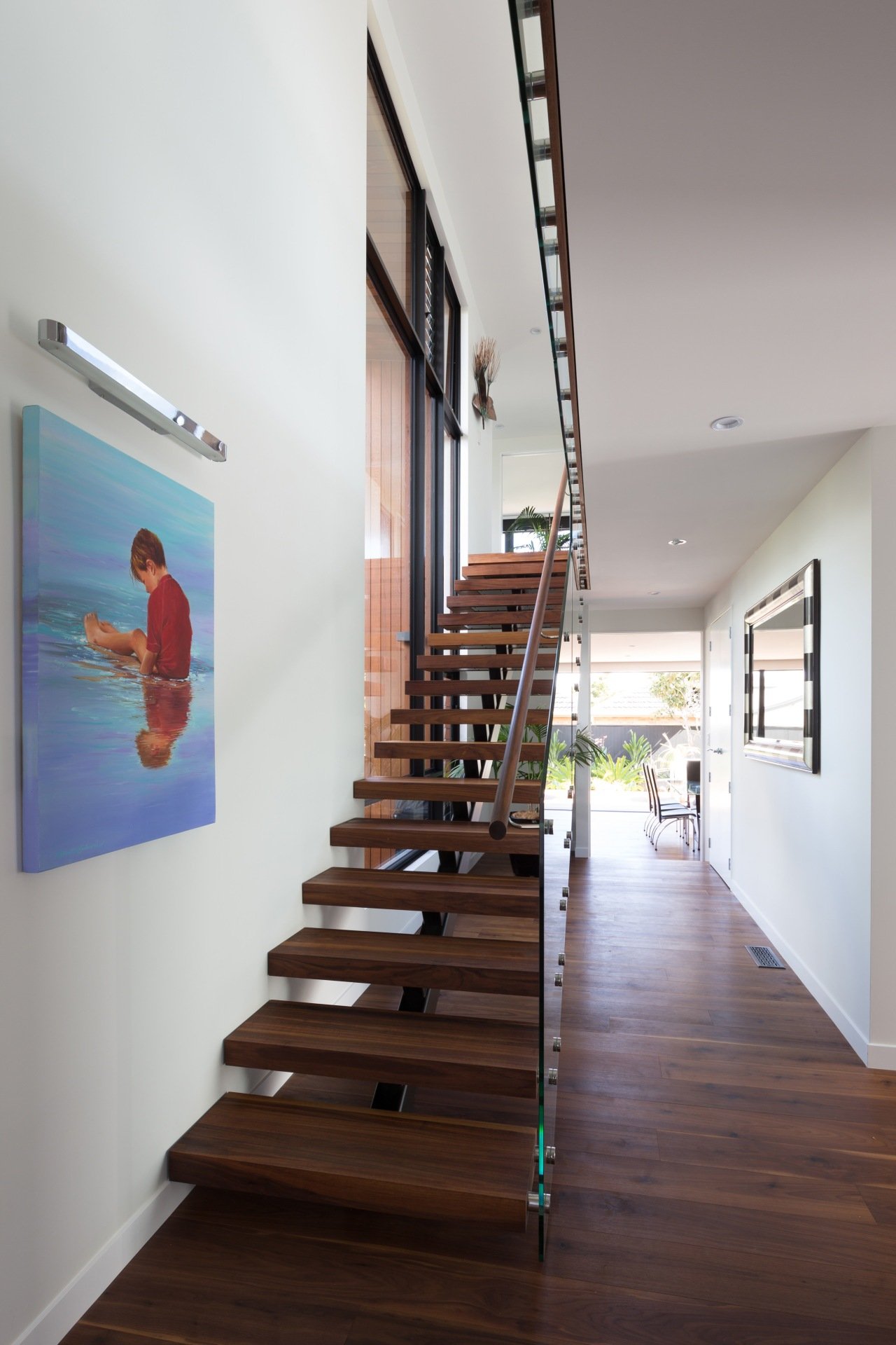 This homes feature walnut, floating staircase is also architecture, daylighting, floor, handrail, house, interior design, product design, stairs, gray