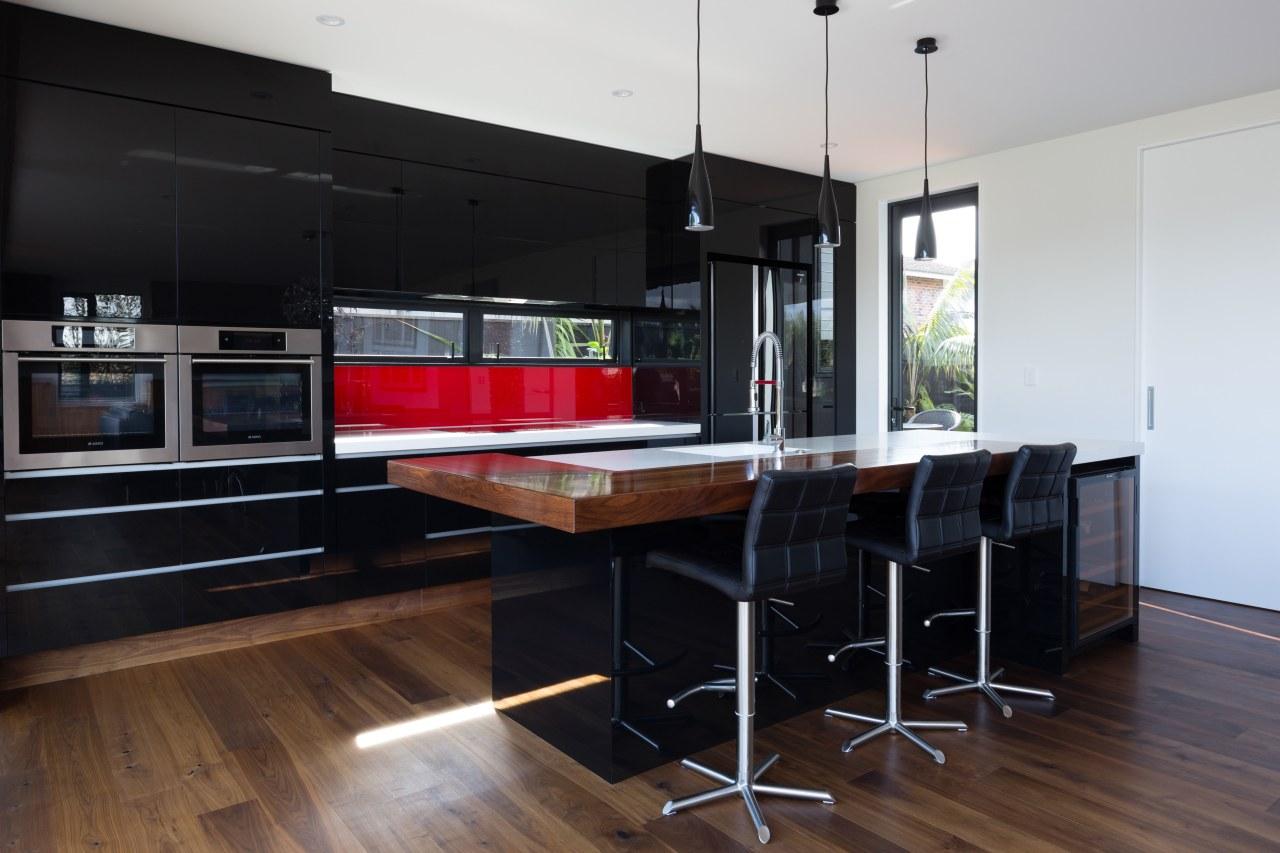 Resene Jalapeno features on the kitchen splashback in countertop, floor, flooring, hardwood, interior design, kitchen, table, black
