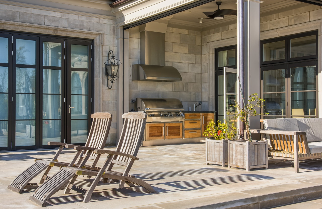 Shirley McFarlane designed this outdoor barbeque area as chair, door, furniture, interior design, outdoor structure, patio, porch, real estate, table, window