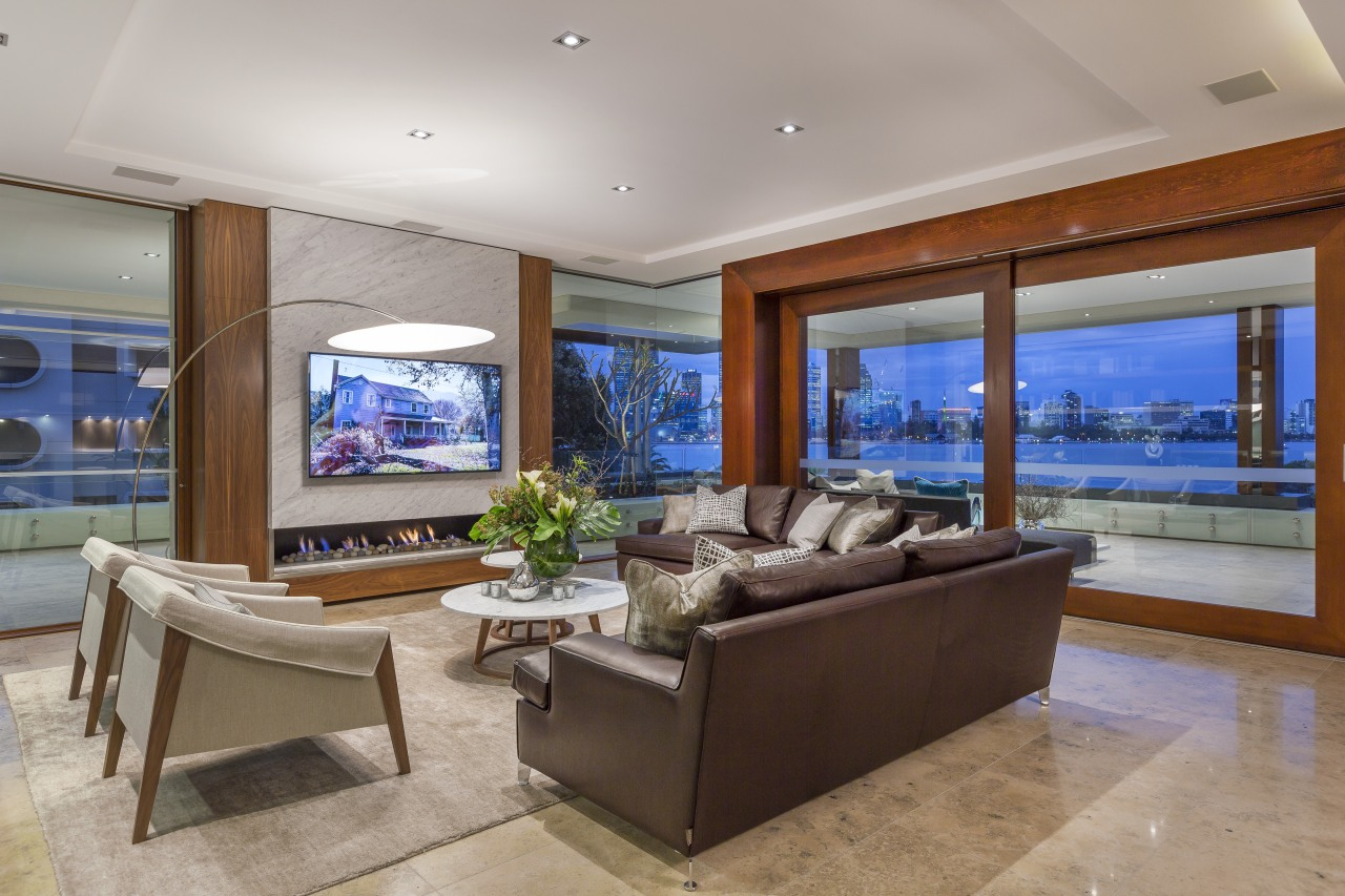 This apartment living space connects to a wrap-around ceiling, estate, home, interior design, living room, penthouse apartment, property, real estate, window, gray