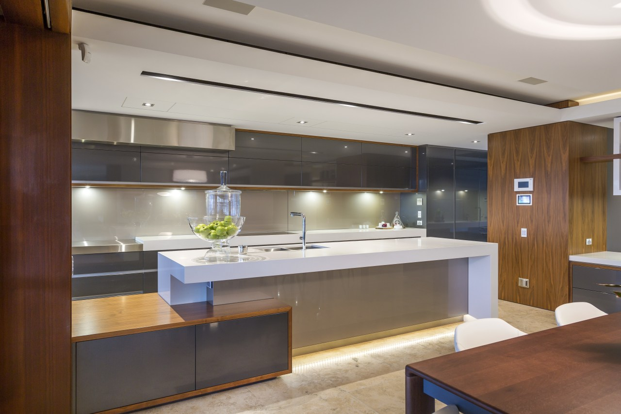 As much a sculptural event as a practical cabinetry, countertop, interior design, kitchen, gray, brown