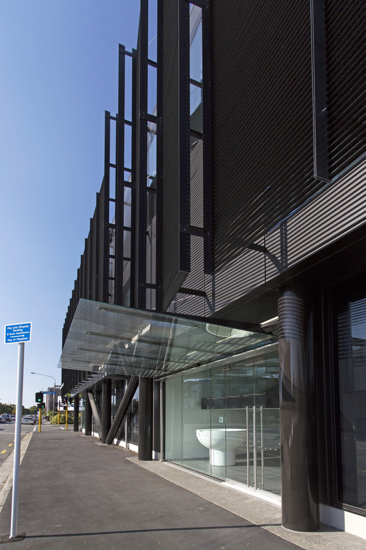 The ground floor of this new Christchurch building architecture, building, commercial building, condominium, corporate headquarters, facade, glass, headquarters, metropolitan area, mixed use, skyscraper, structure, black, gray