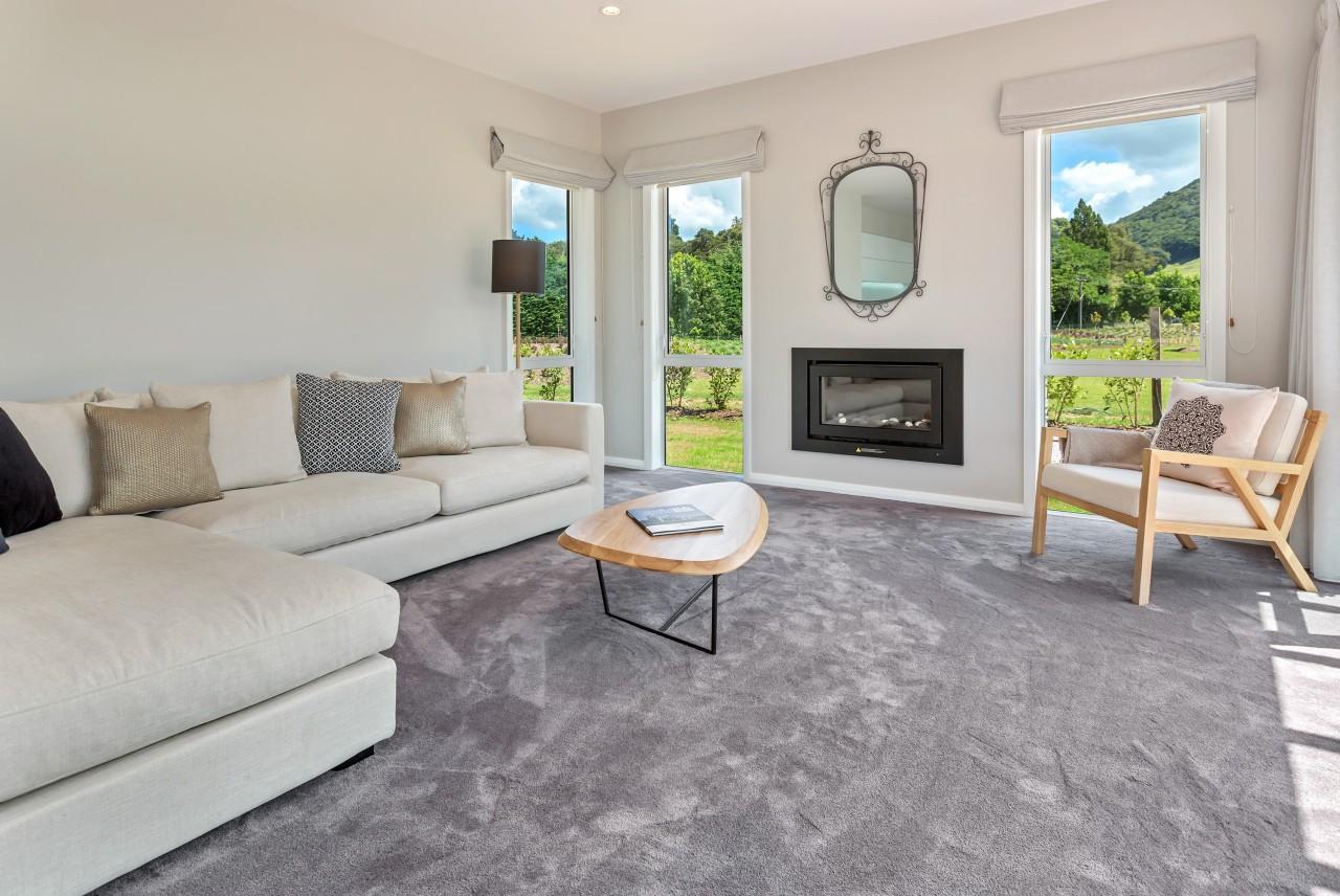 The separate lounge in Landmark Homes show home estate, floor, flooring, hardwood, home, interior design, laminate flooring, living room, property, real estate, room, window, wood flooring, gray