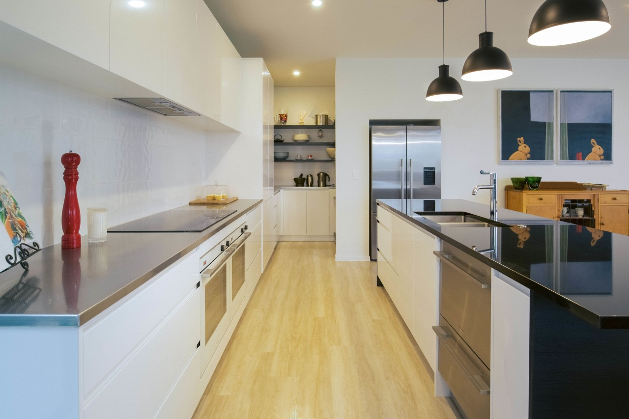 This clean-lined, contemporary kitchen is by Apollo Kitchen countertop, cuisine classique, floor, interior design, kitchen, property, real estate, room, gray