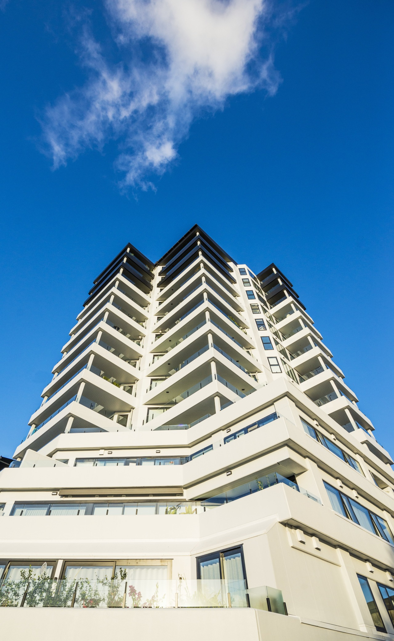 Angular balconies give Hopetoun Residences its individual architectural architecture, building, commercial building, condominium, corporate headquarters, daylighting, daytime, estate, facade, landmark, metropolitan area, real estate, residential area, sky, tower block, blue, white