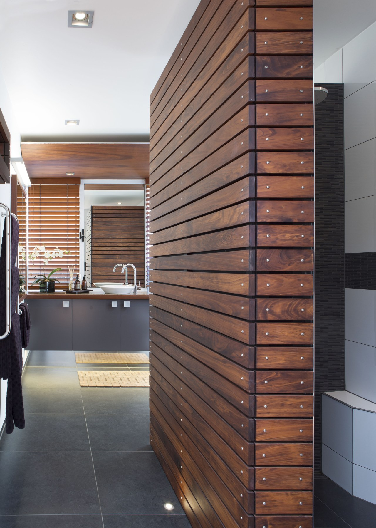 On this bathroom renovation, the black external wall architecture, daylighting, facade, floor, flooring, furniture, hardwood, interior design, wall, wood, wood stain, red