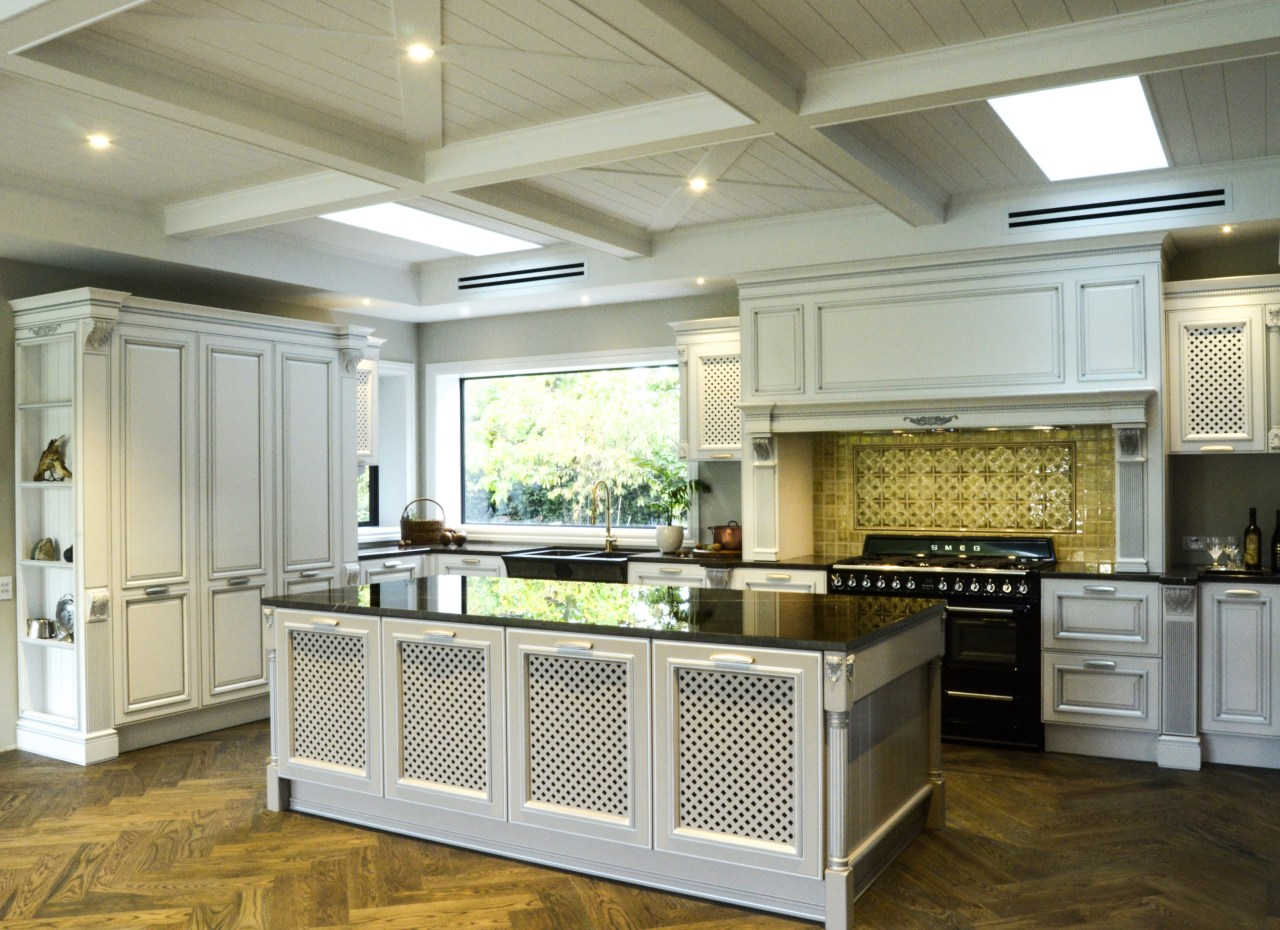In this kitchen, the tongue & groove treatment cabinetry, ceiling, countertop, cuisine classique, floor, flooring, interior design, kitchen, room, wood flooring, gray, brown