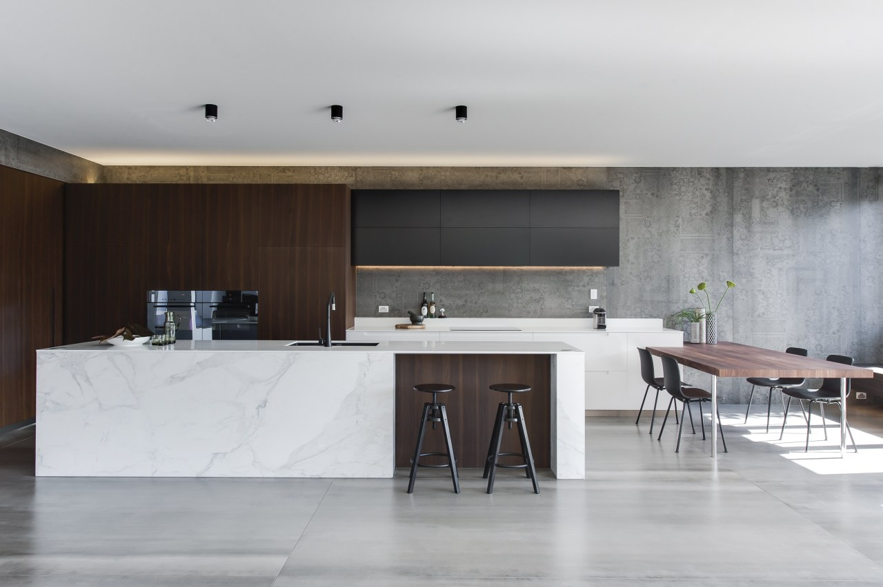 This contemporary kitchen provides a sculptural focus for architecture, floor, furniture, house, interior design, kitchen, product design, table, gray